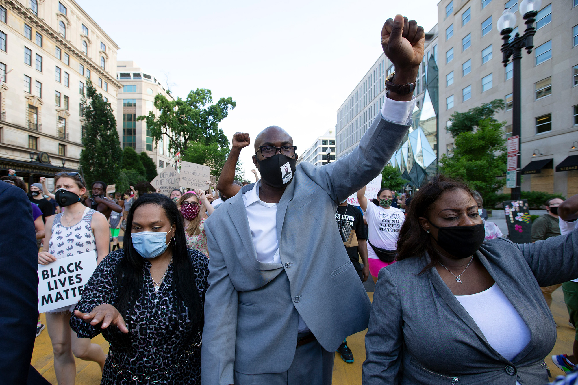 Philonise Floyd (C), George Floyd's brother, holds up his fist as he marches with others on Black Lives Matter Plaza near the White House, to protest police brutality and racism, on June 10, 2020 in Washington, DC.