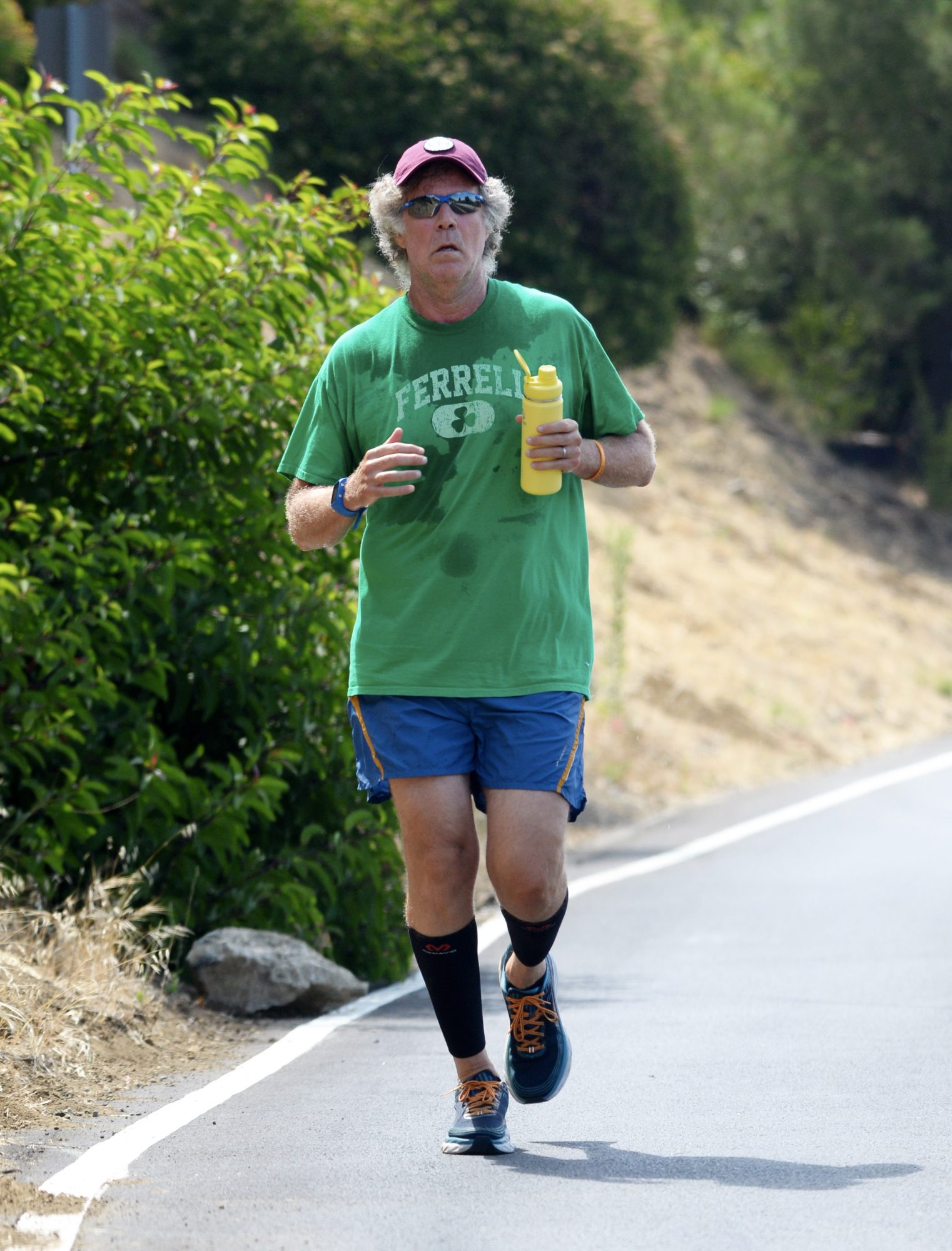 Will Ferrell goes for a Father's Day morning jog in a T-shirt with his name on it in Los Angeles.