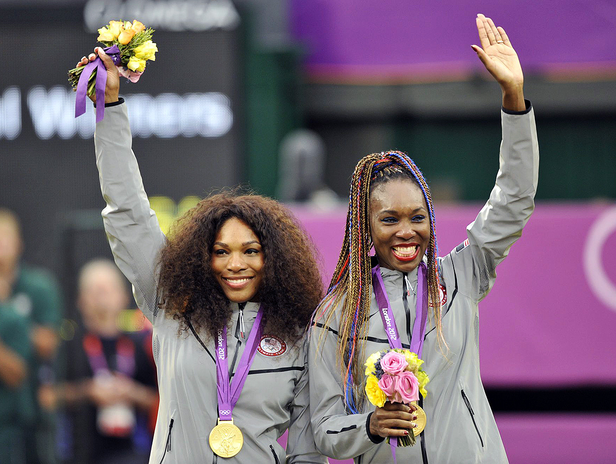 Serena Williams and Venus Williams after winning gold in the Women's Doubles The 2012