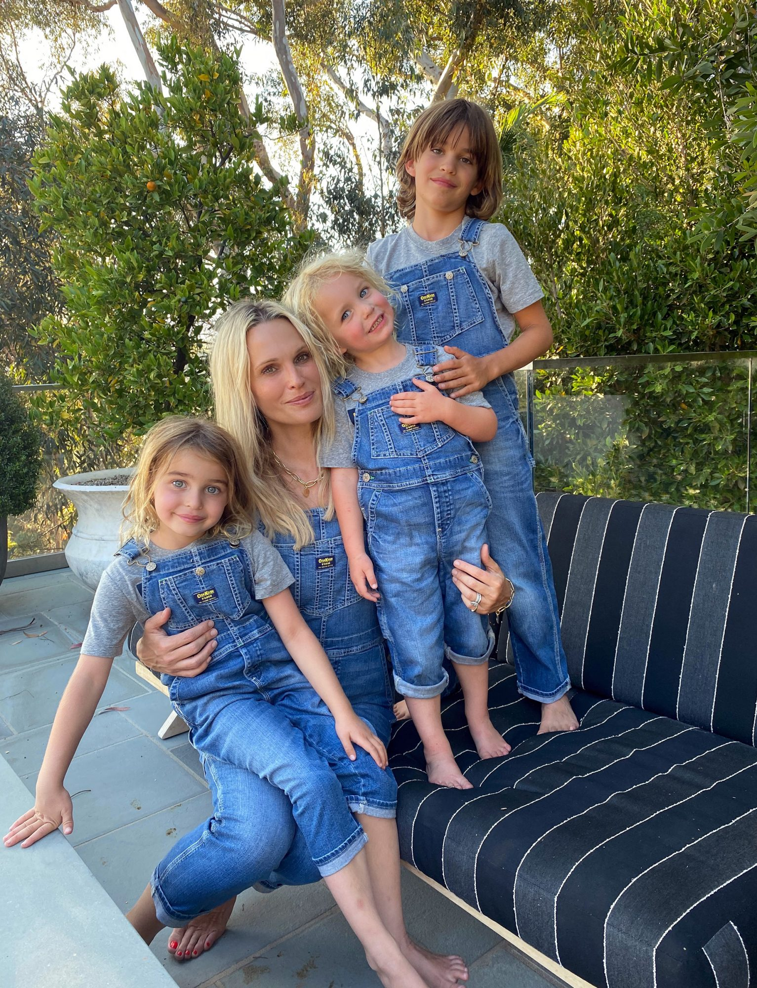 Molly Sims enjoys Camp OshKosh with kids wearing the brand's limited edition family overalls