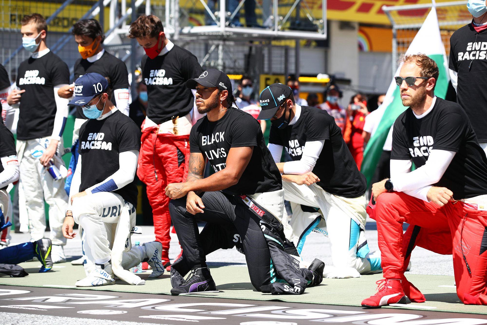 Lewis Hamilton of Great Britain and Mercedes GP and some of the F1 drivers take a knee on the grid in support of the Black Lives Matter movement ahead of the Formula One Grand Prix of Austria at Red Bull Ring on July 05, 2020