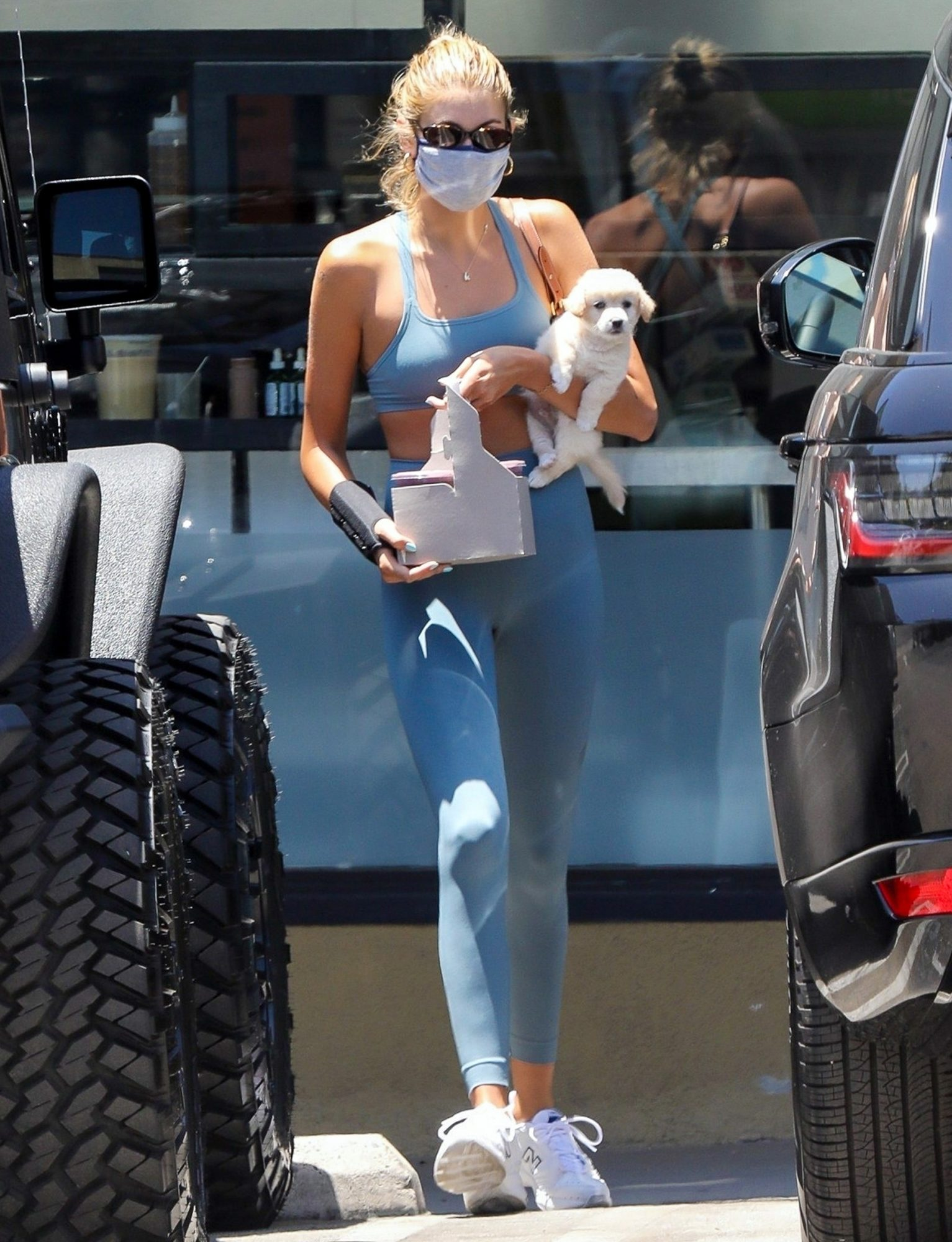 Kaia Gerber grabs a healthy drink at Earthbar with her adorable foster pup