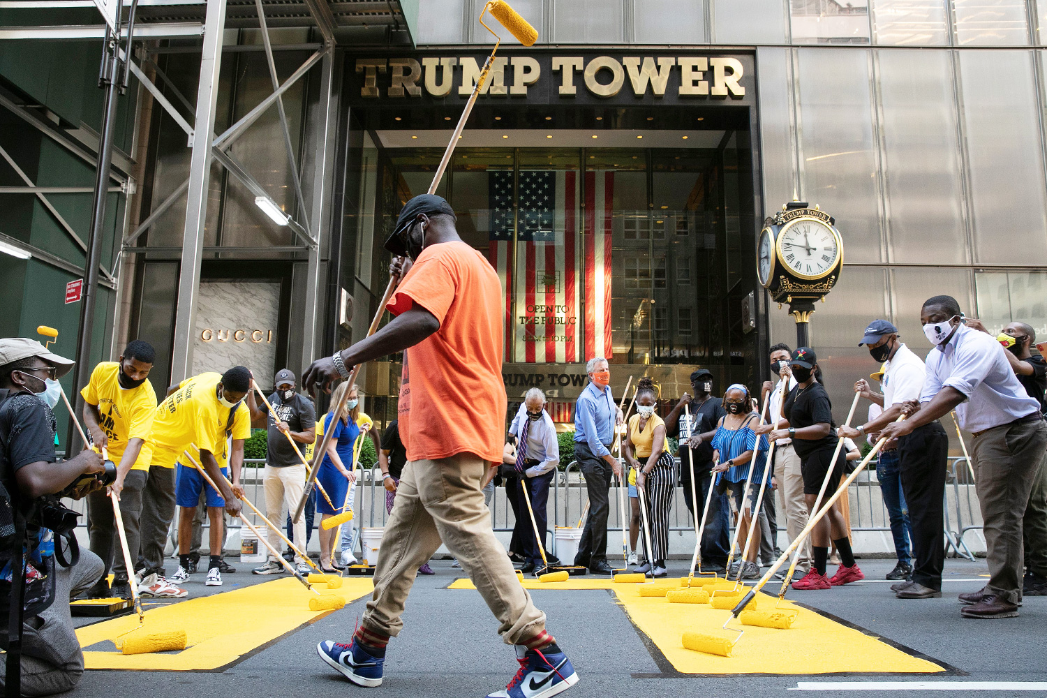 Black Lives Matter is painted on Fifth Avenue in front of Trump Tower, in New York