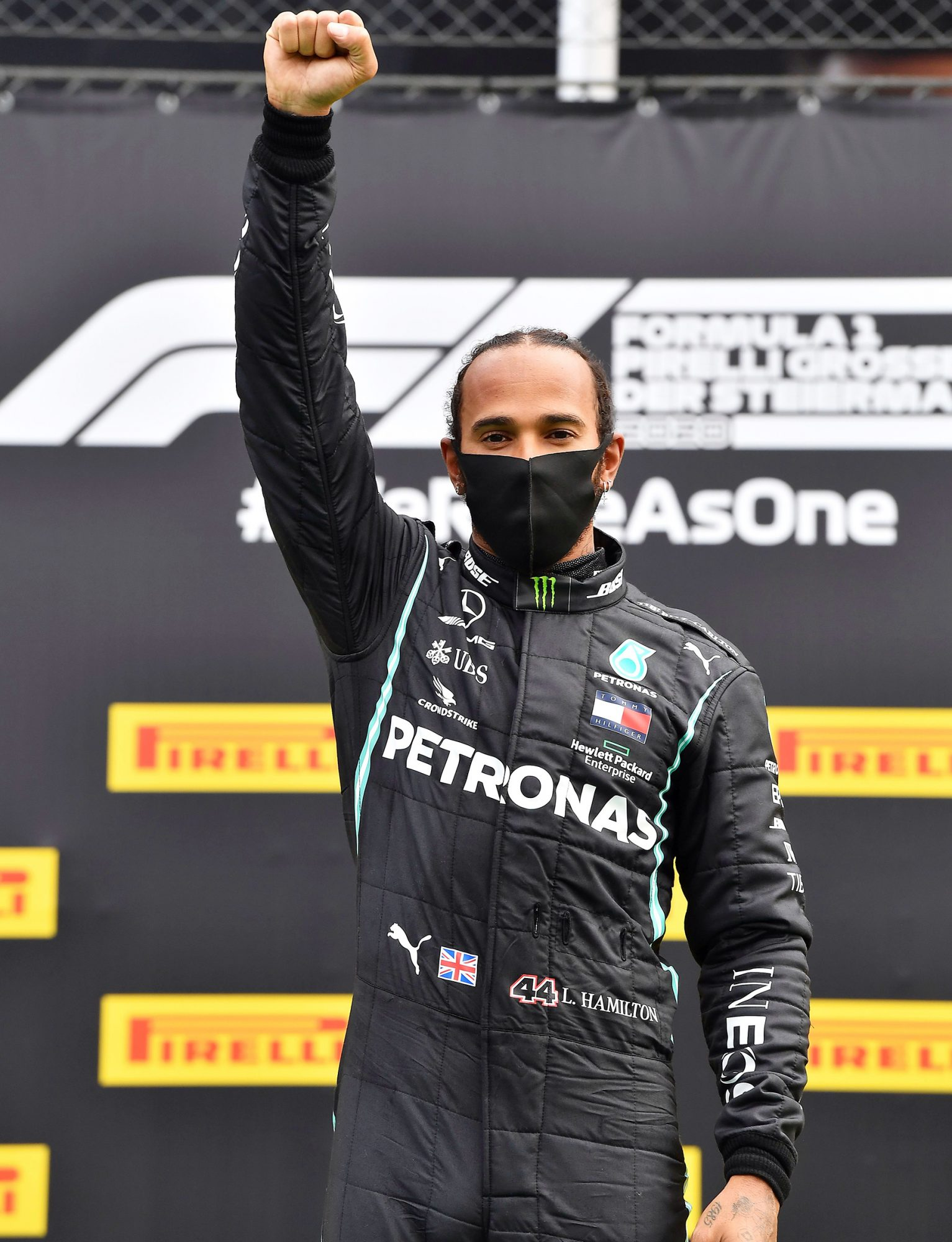 Mercedes driver Lewis Hamilton of Britain celebrates on the podium after winning the Styrian Formula One Grand Prix at the Red Bull Ring racetrack in Spielberg, Austria, Sunday, July 12, 2020. (Joe Klamar/Pool via AP) Styrian Grand Prix, Formula One Motor Racing, Red Bull Racetrack, Spielberg, Austria - 12 Jul 2020