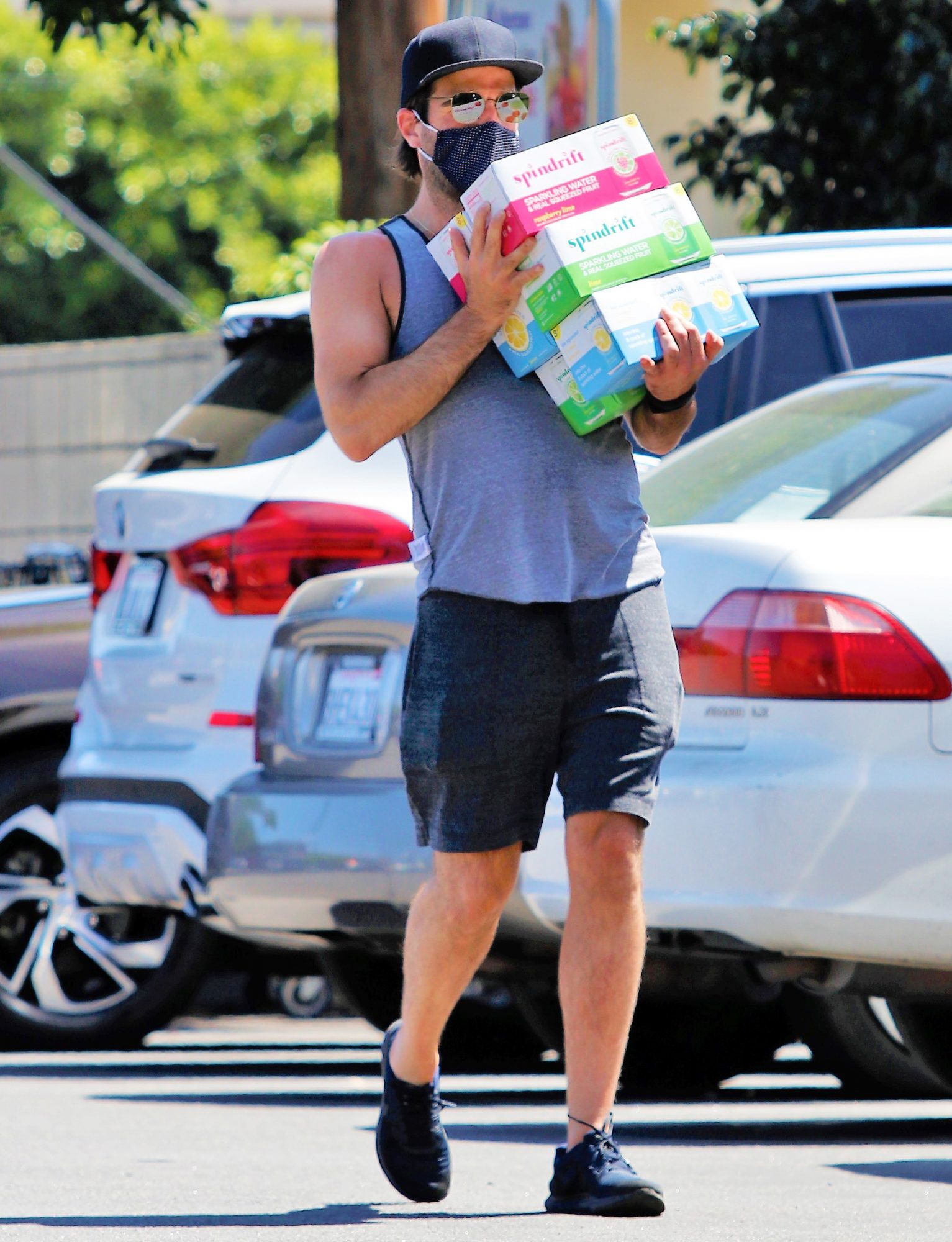 Zachary Quinto Has His Hands Full With Multiple Cases of Flavored Water in Los Angeles