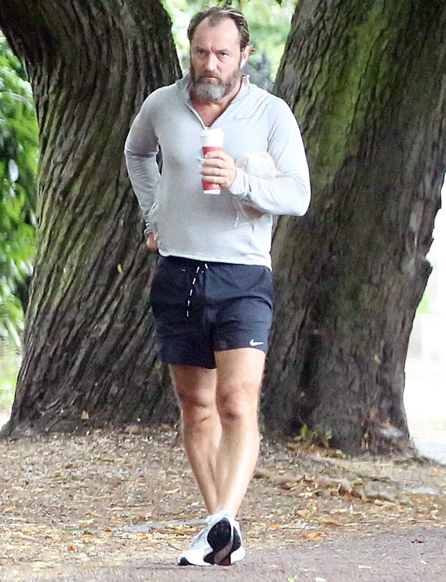Jude Law returns with coffee after a early morning run