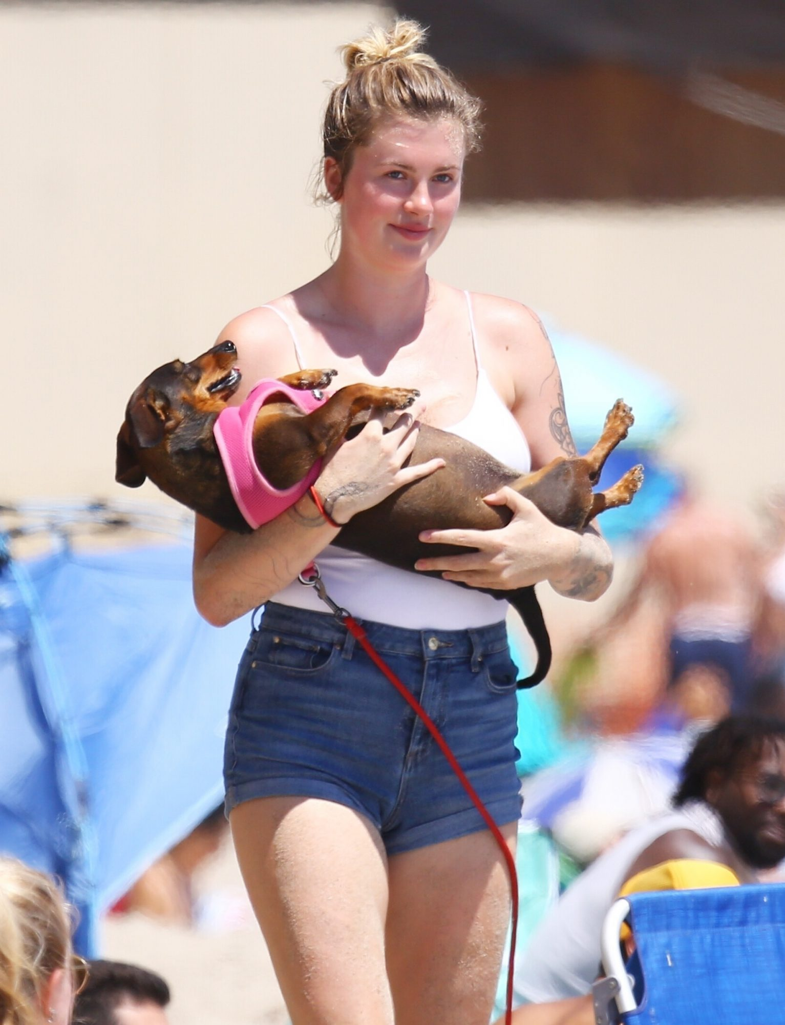 Ireland Baldwin is all smiles while out having a fun day at the beach with her friends.