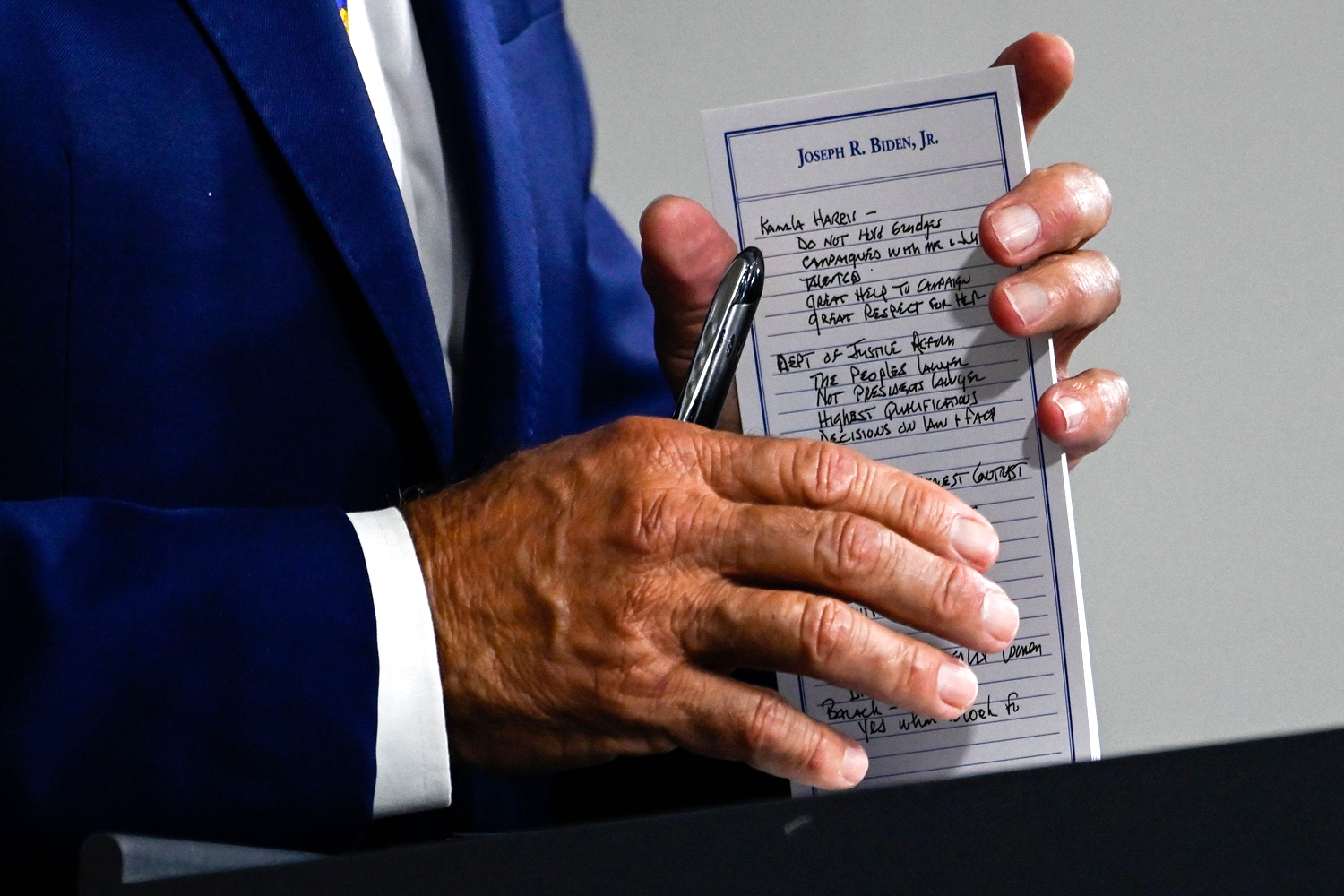 Joe Biden holds a pad with potential Vice Presidential names