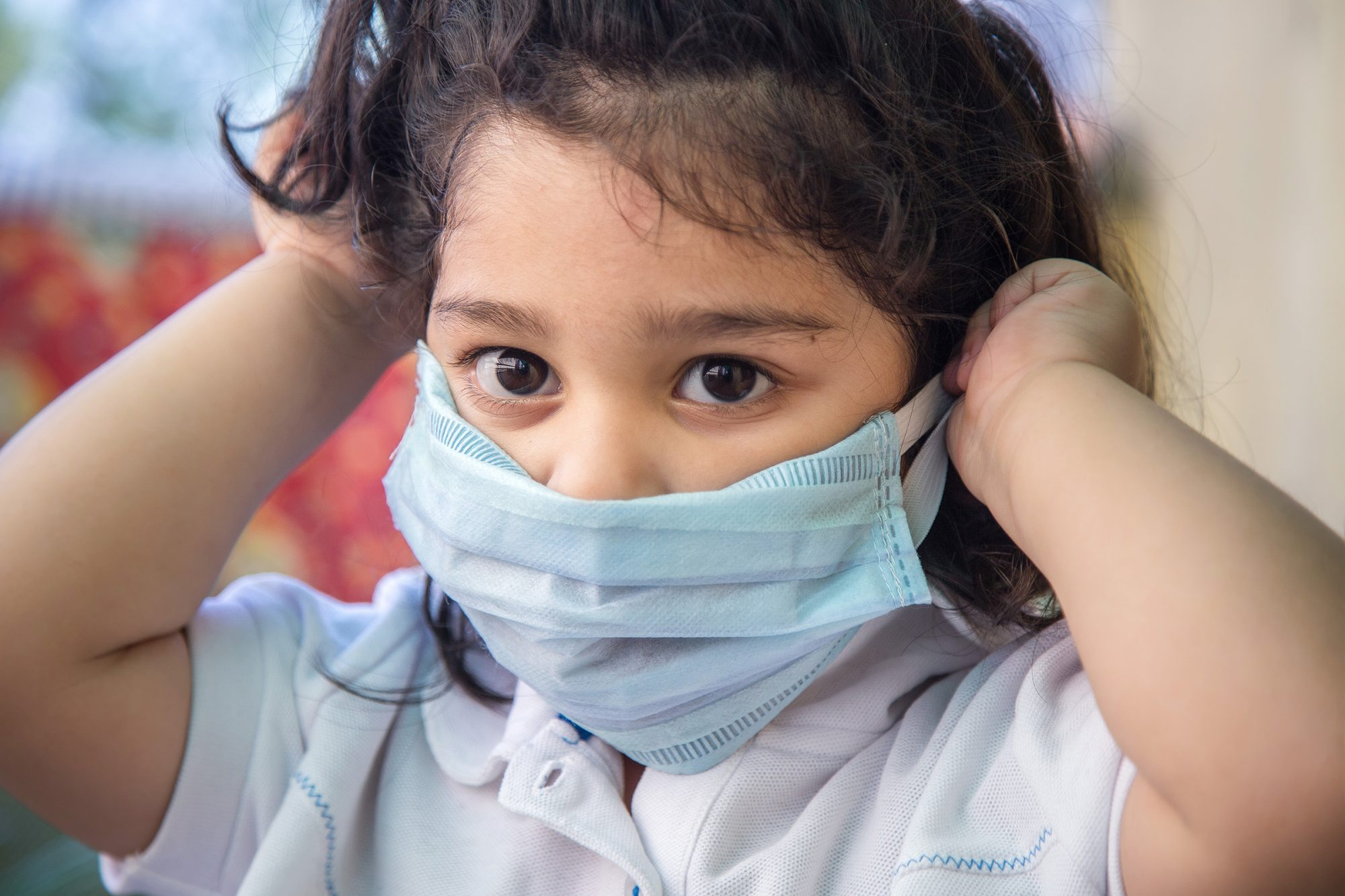 girl wearing mask for stop corona virus outbreak