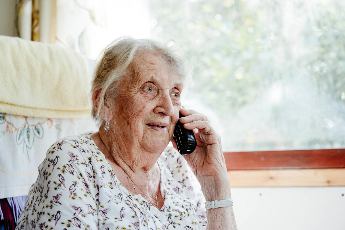 Volunteer Anne receiving a call from HRH Princess Alexandra