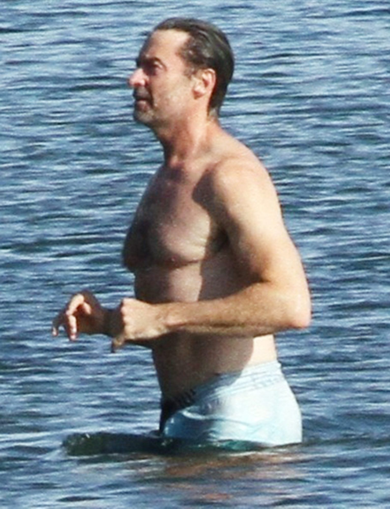 Hugh Jackman Goes For A Swim After Walking Dog In The Hampton's