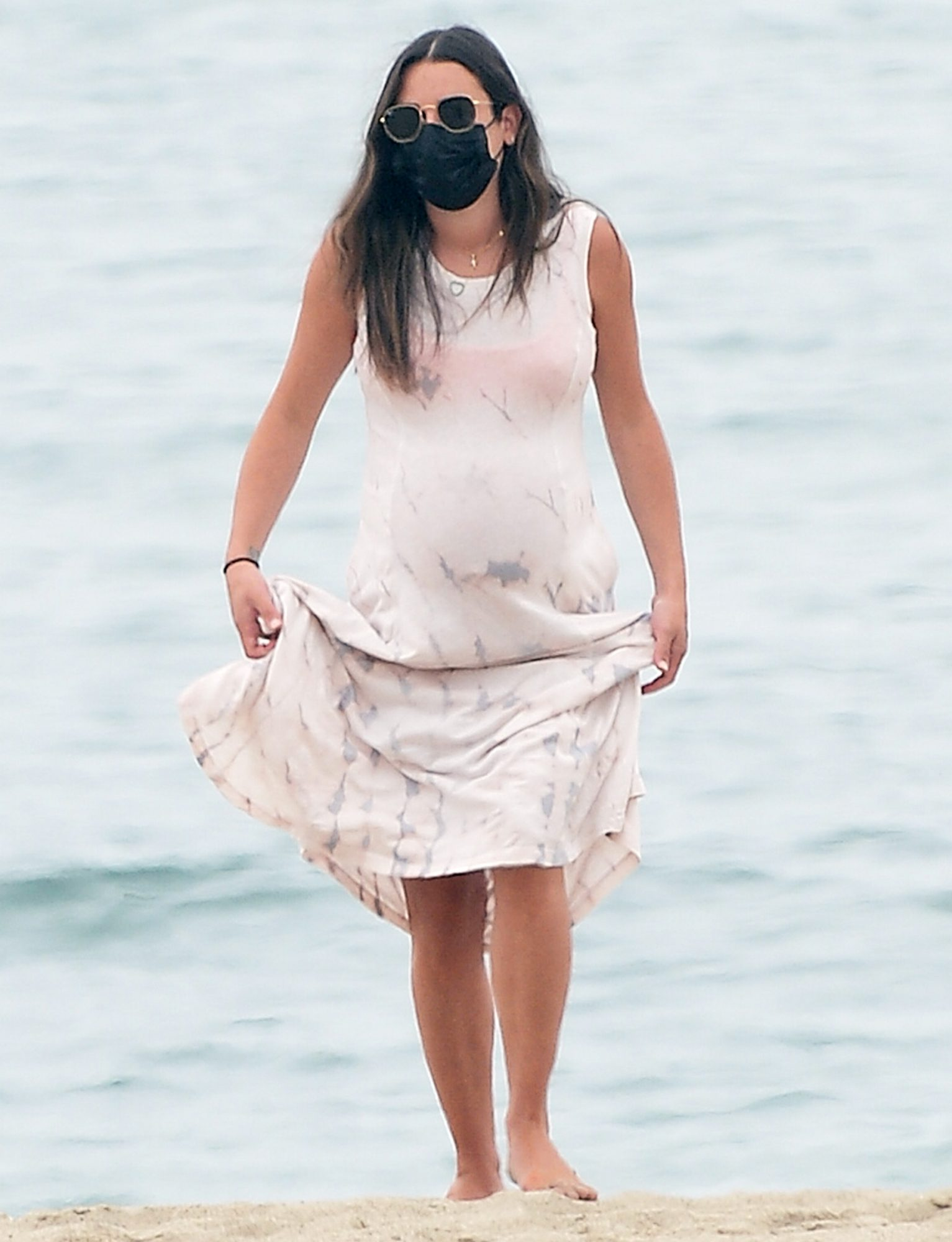 Lea Michele Cradles Her Growing Baby Bump on The Beach in Santa Monica, California.