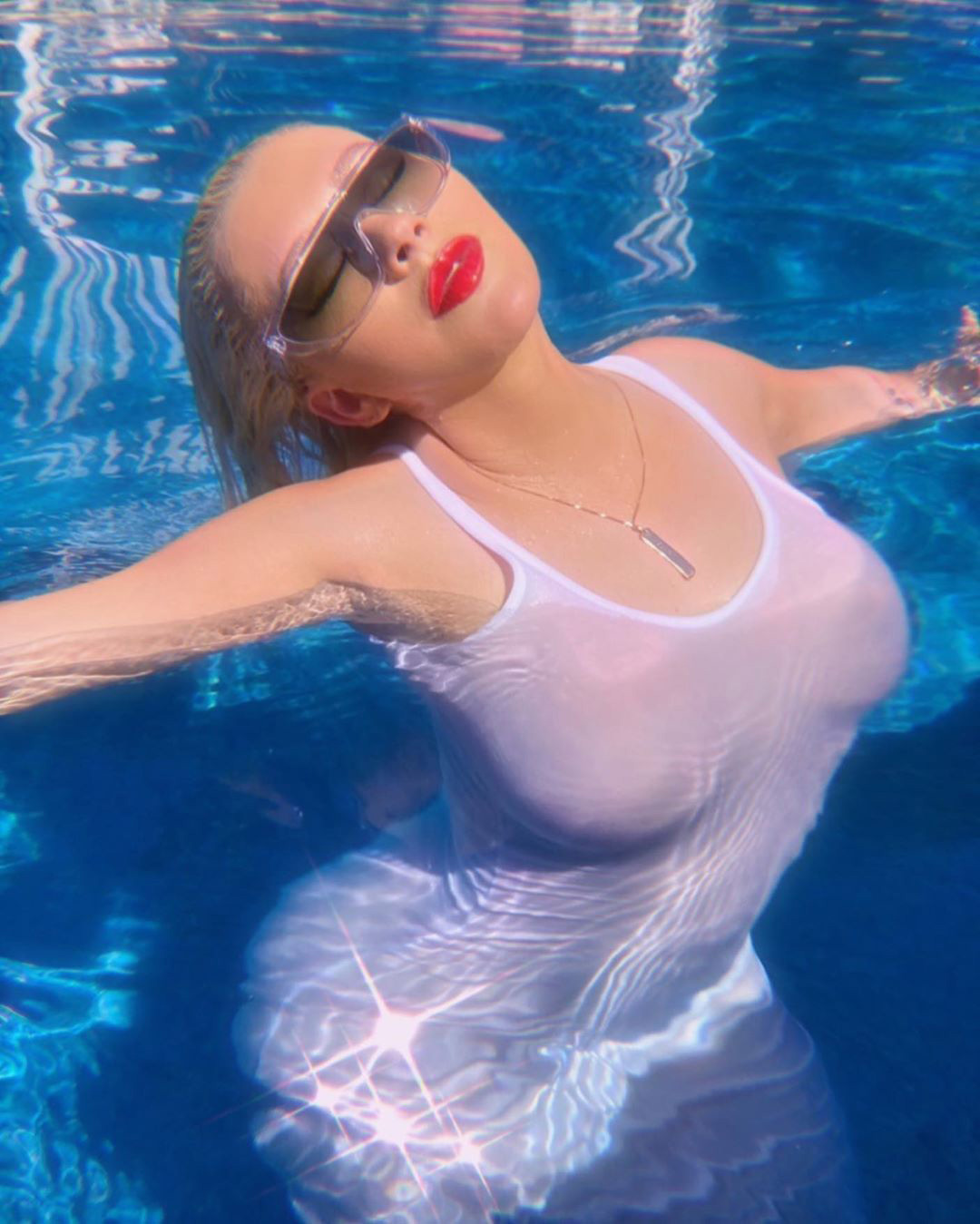Christina Aguliera Shouts Out 'WAP' Music Video as She Wears Skin-Tight White Dress in Her Pool