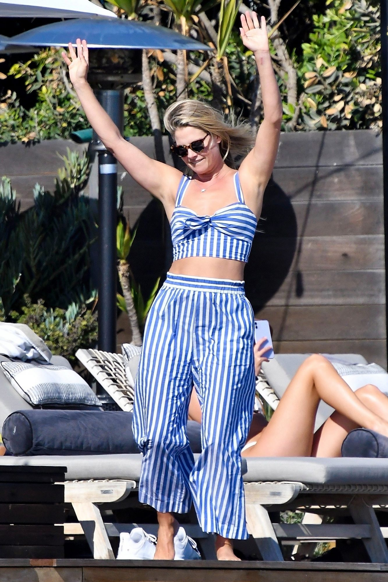 Ali Larter looks to be enjoying herself as she dances with a cocktail at a Malibu beach house party.