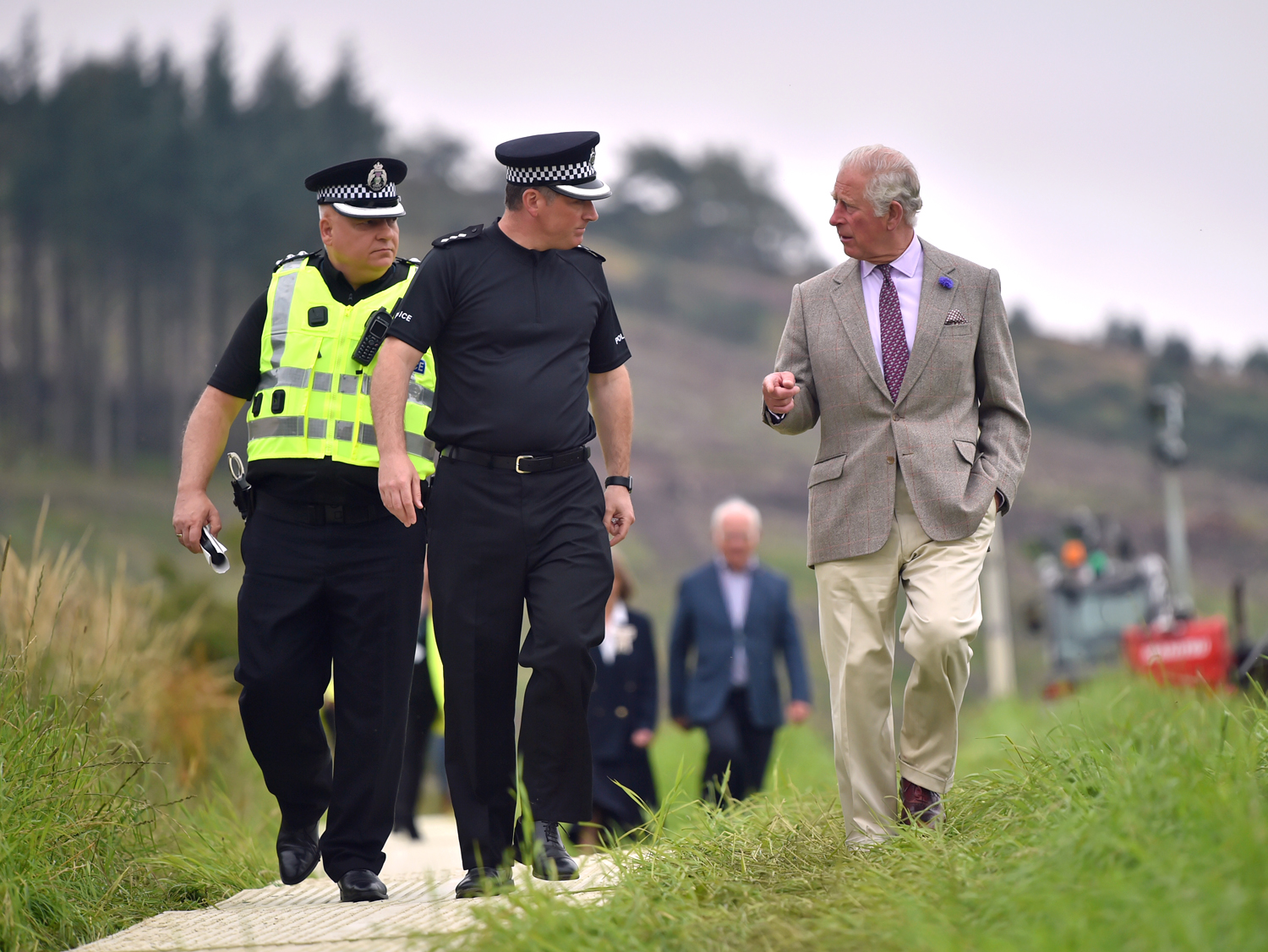 The Prince of Wales is shown the scene of the ScotRail train derailment near Stonehaven