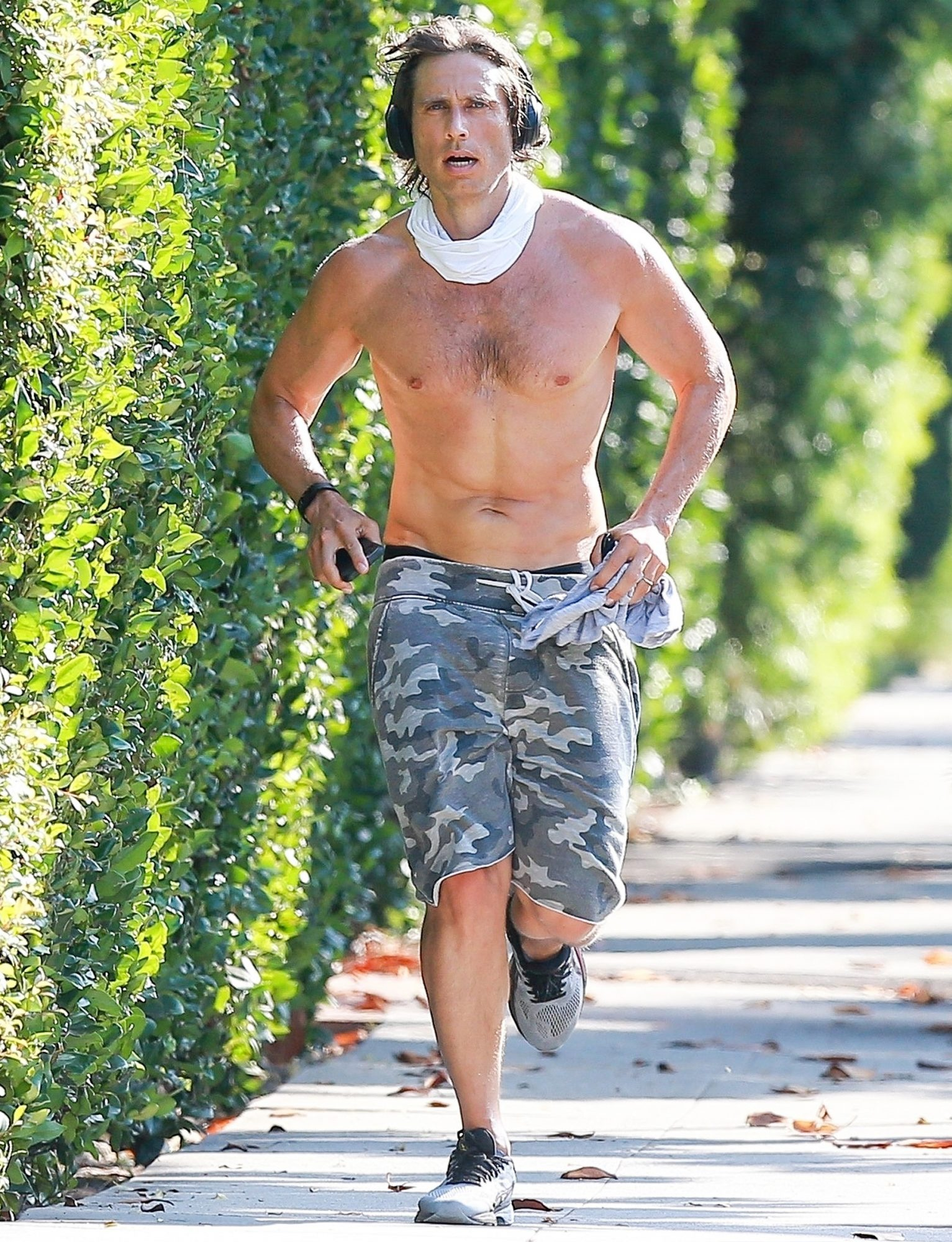 Brad Falchuk stays in shape while out jogging shirtless