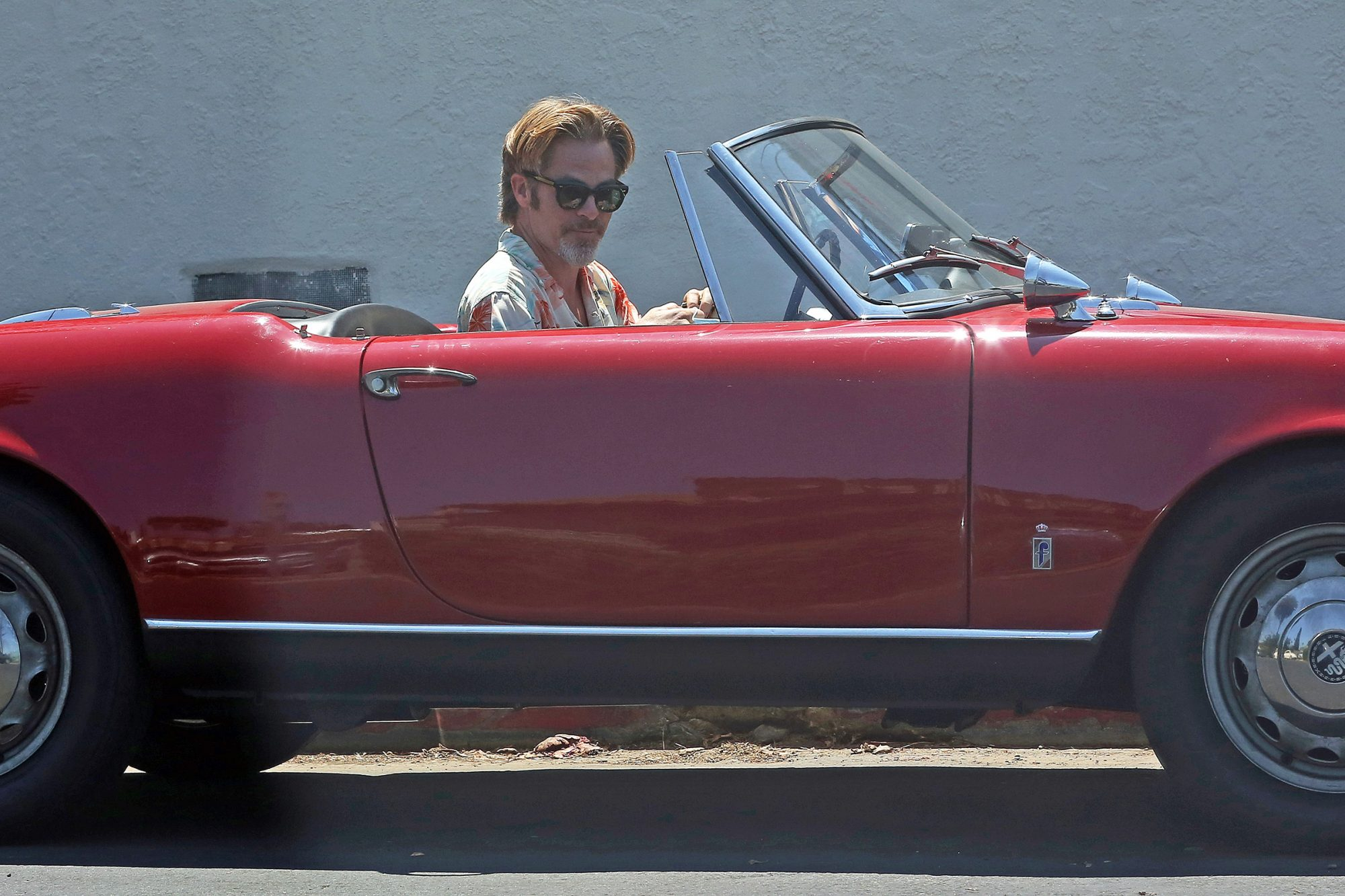 Chris Pine out for a drive in his classic red convertible