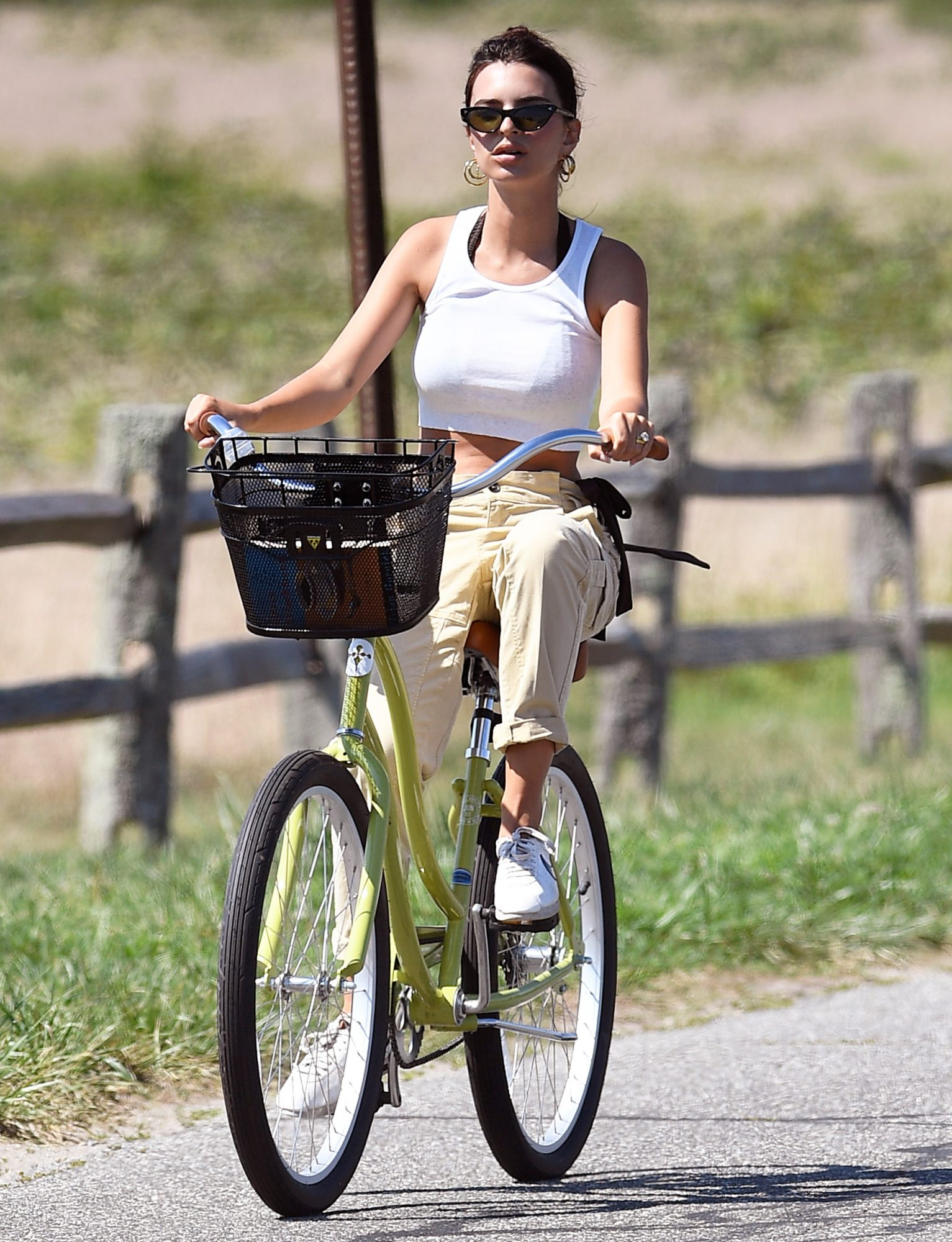 Emily Ratajkowski goes for a bike ride in the Hamptons before heading to the beach