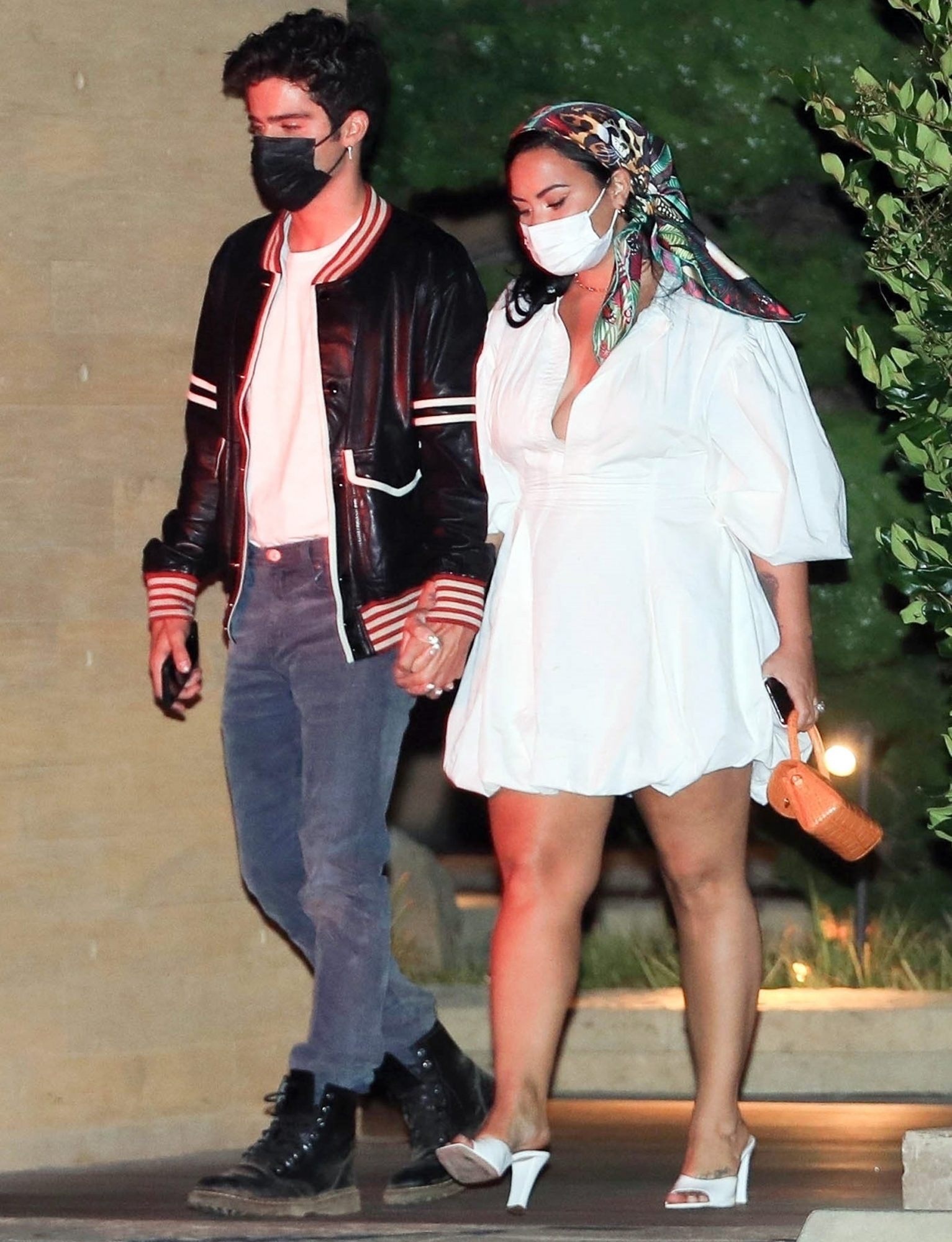 Demi Lovato shares a smooch with her Fiancè Max Ehrich after a dinner date at Nobu!