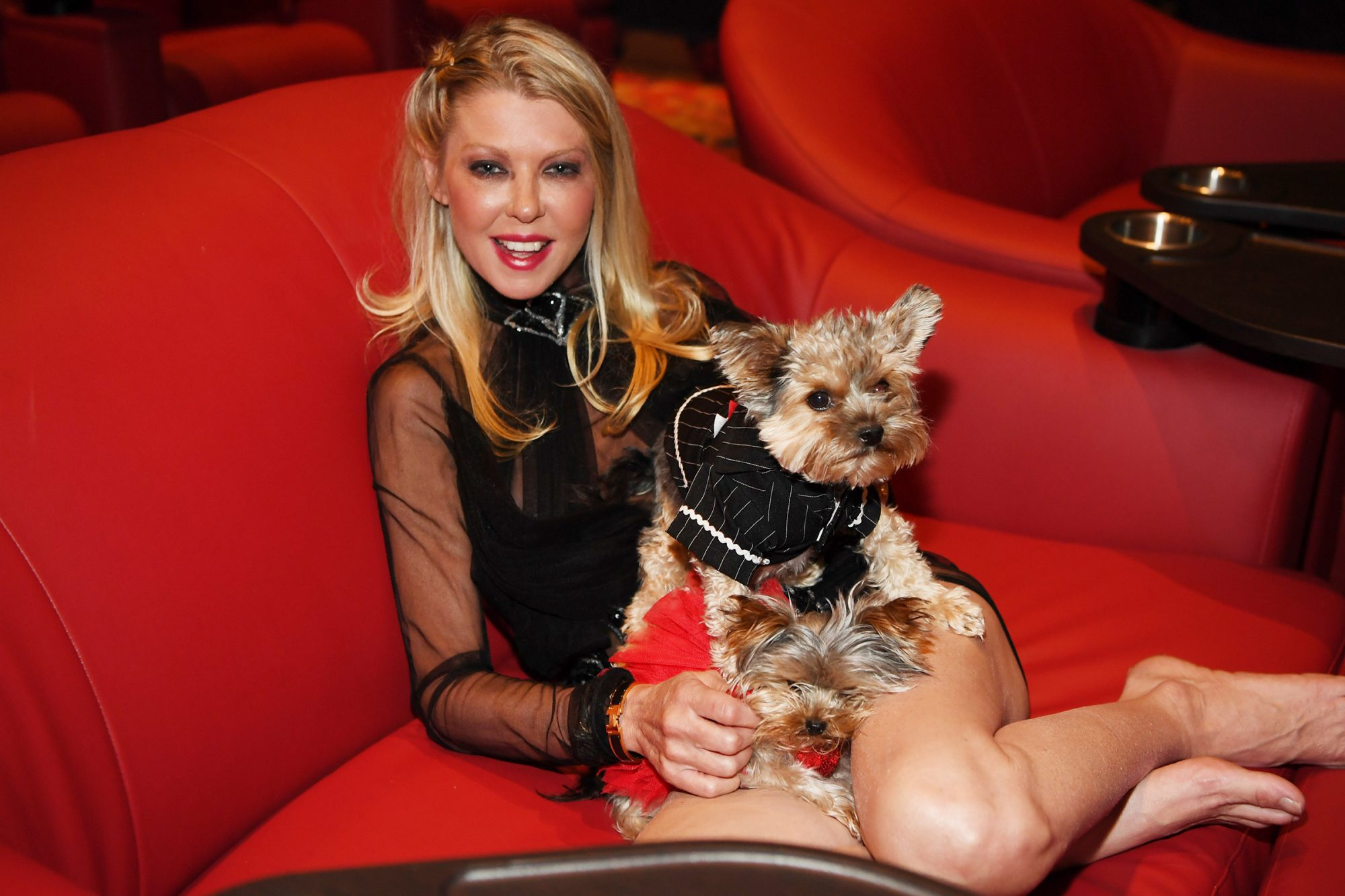 """Tara Reid poses for a photo with her dogs at """"Attack of the Unknown"""" movie release at Galaxy Theatres Boulevard Mall on August 28, 2020 in Las Vegas, Nevada"""