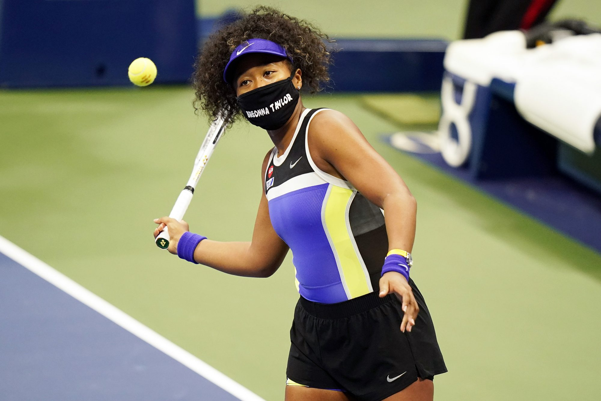 Naomi Osaka, of Japan, wears a mask in honor of Breonna Taylor as she celebrates after defeating Misaki Doi