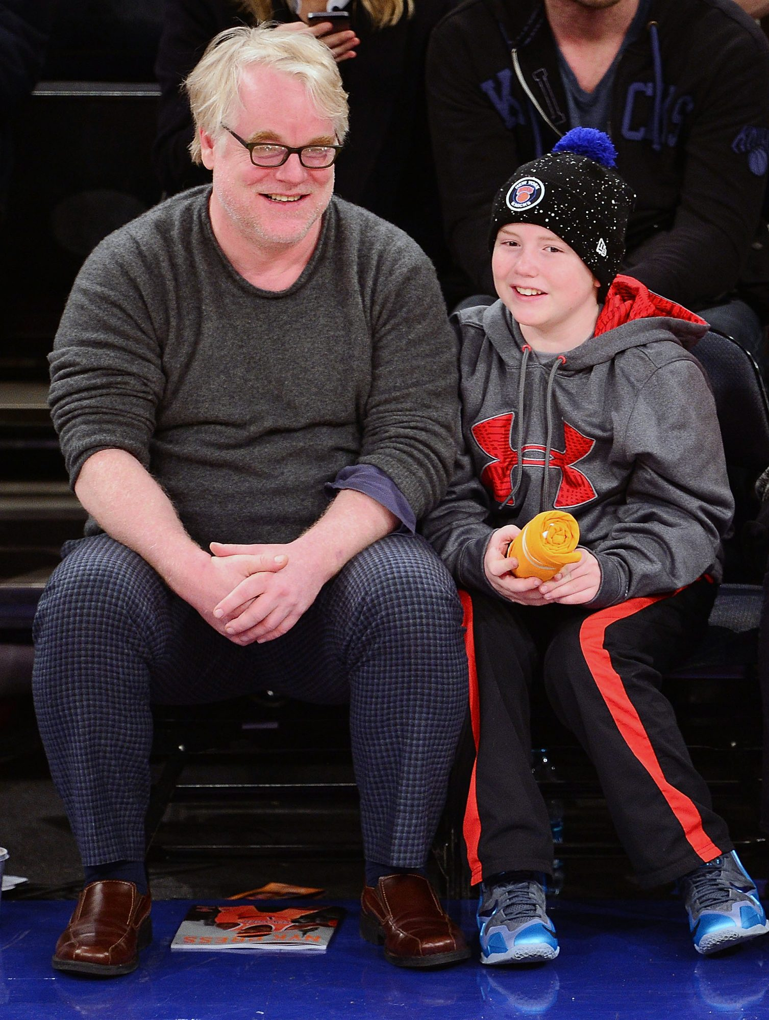 NEW YORK, NY - DECEMBER 25: Phillip Seymour Hoffman and Cooper Alexander Hoffman attend the Oklahoma City Thunder vs New York Knicks game at Madison Square Garden on December 25, 2013 in New York City. (Photo by James Devaney/WireImage)