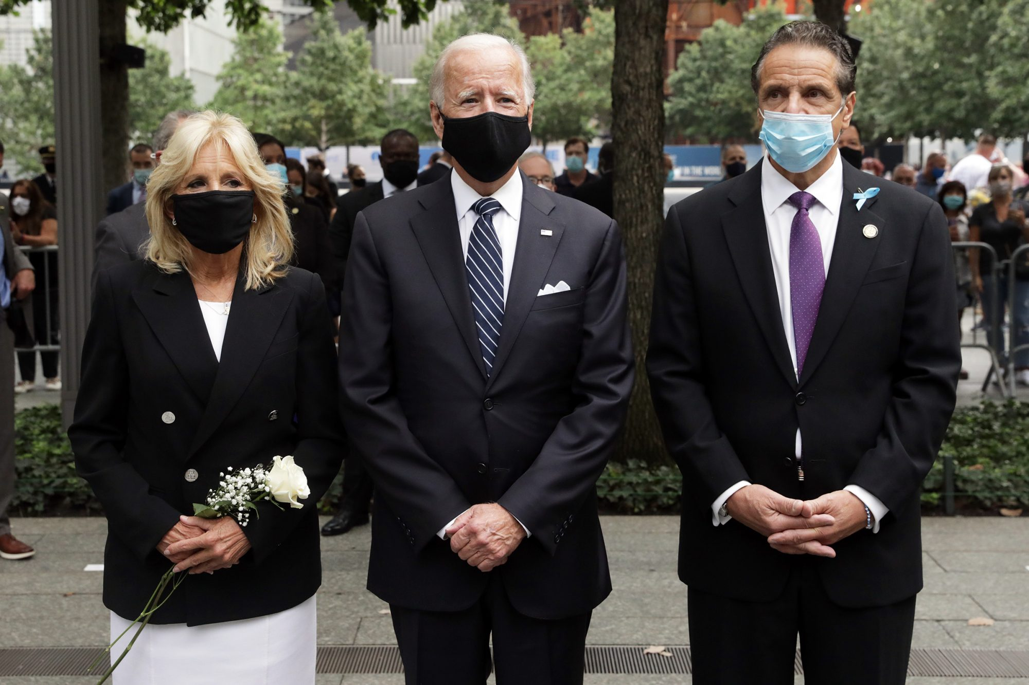 Democratic presidential nominee Joe Biden (center), Dr. Jill Biden (left) and New York Gov. Andrew Cuomo (right) attend a 9/11 memorial service at the National September 11 Memorial and Museum on September 11, 2020