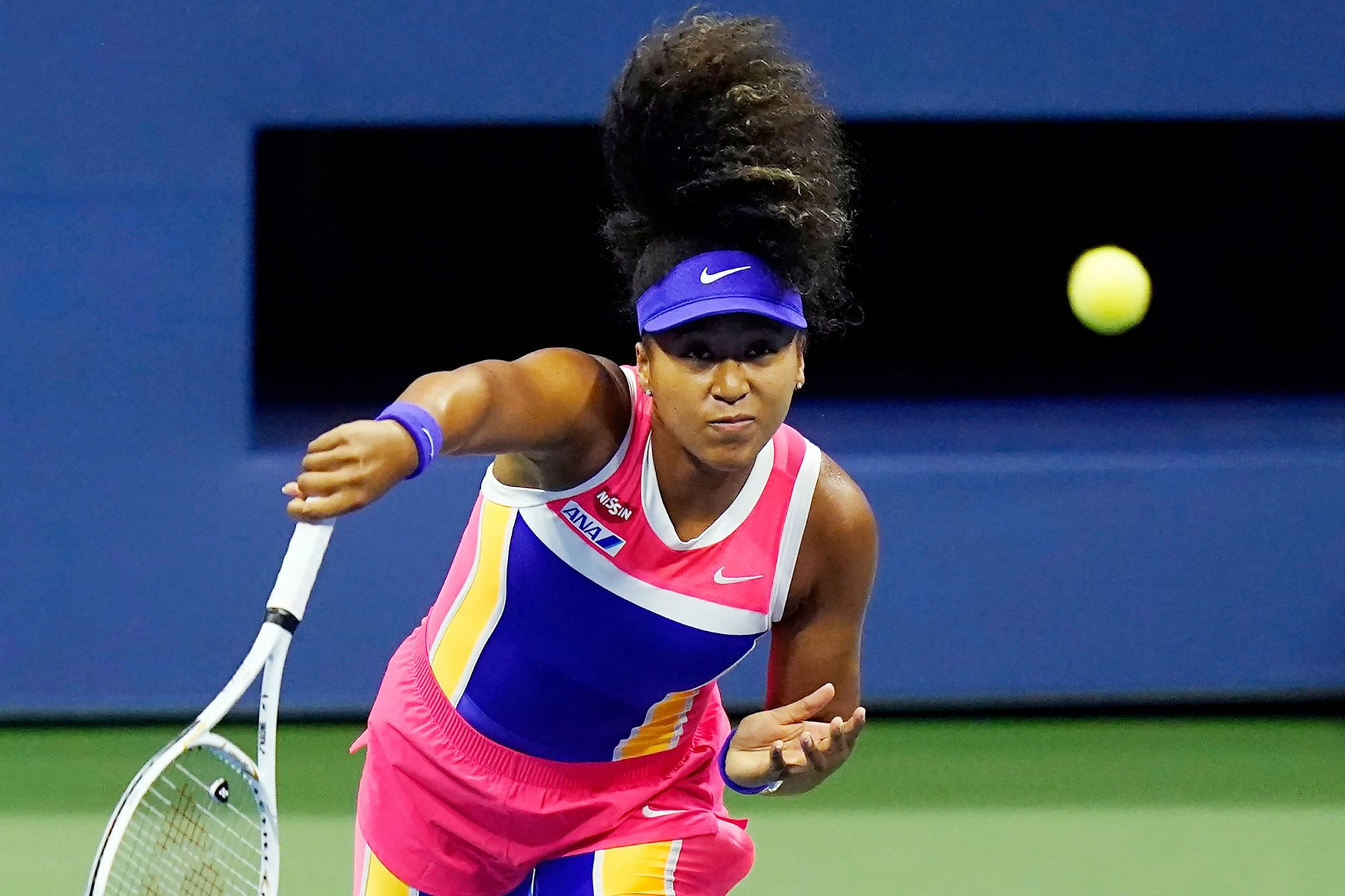 Naomi Osaka, of Japan, returns a shot to Anett Kontaveit, of Estonia, during the fourth round of the US Open tennis championships, in New York