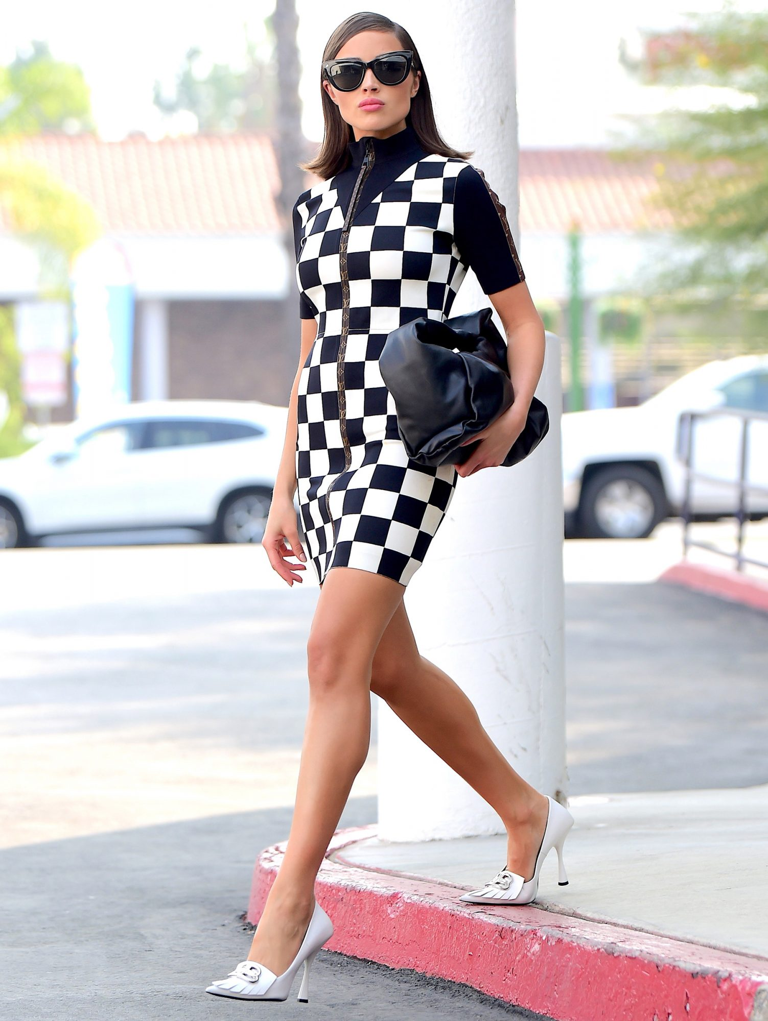 Olivia Culpo Checks All Of The Right Boxes in Louis Vuitton Dress After Business Meeting In LA