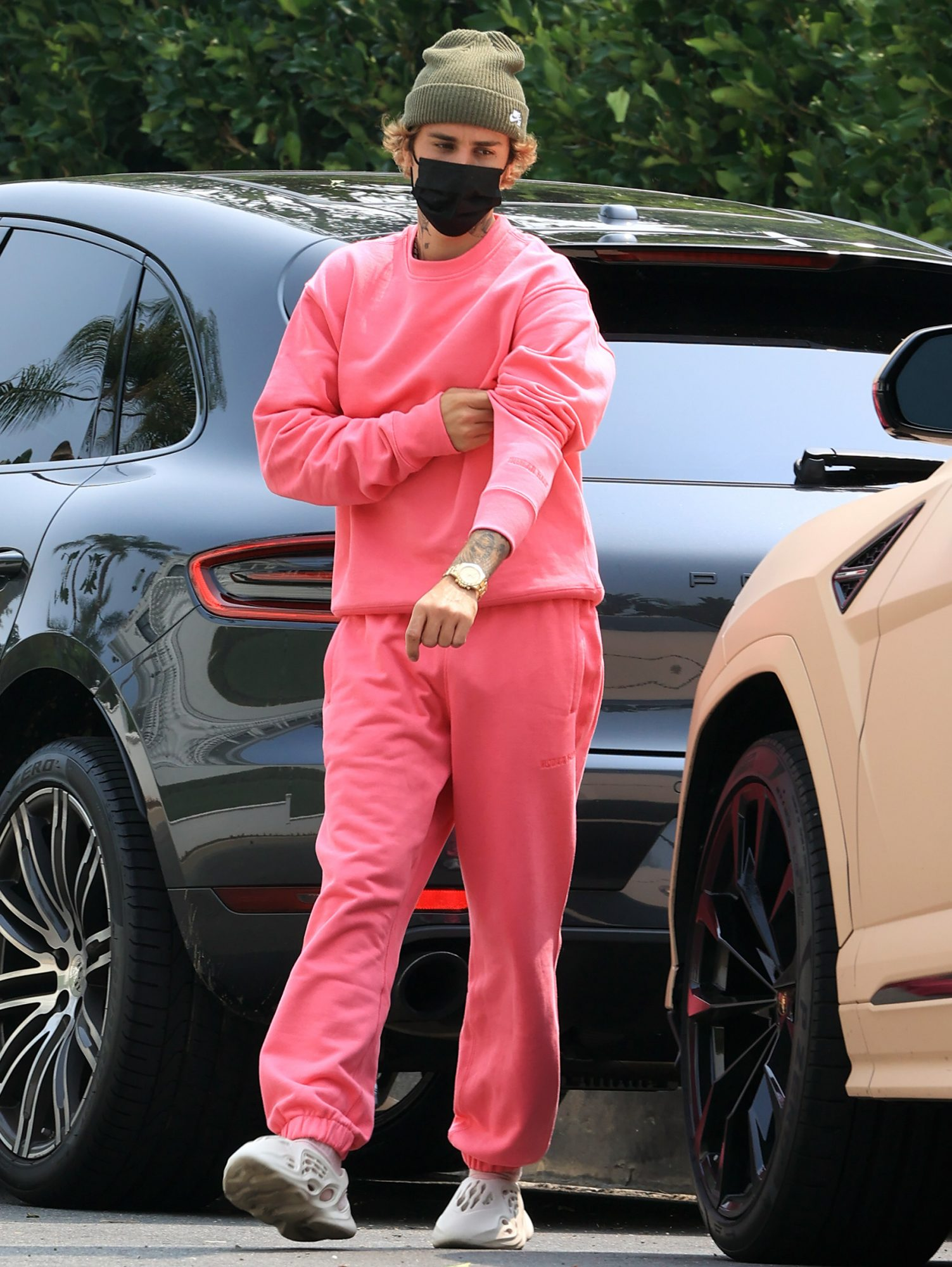 Justin Bieber rocks a hot pink outfit during outing with wife Hailey