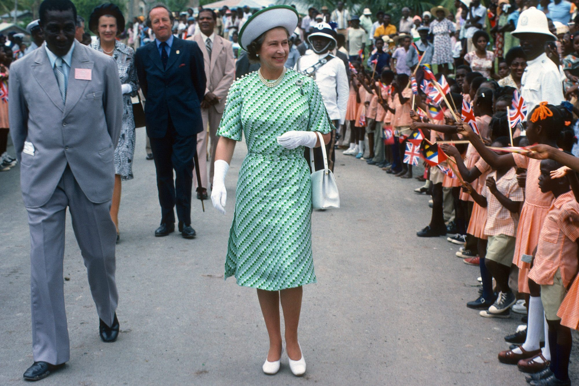 Queen Elizabeth ll is greeted by the public during a walkabout in Barbados on November 01, 1977 in Barbados