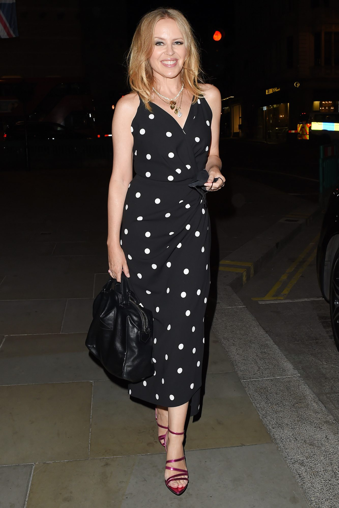 Kylie Minogue Channels Her Inner Pretty Woman With A Polka Dot Dress, As She Enjoys A Night Out At The Ritz Hotel In Mayfair With Friends
