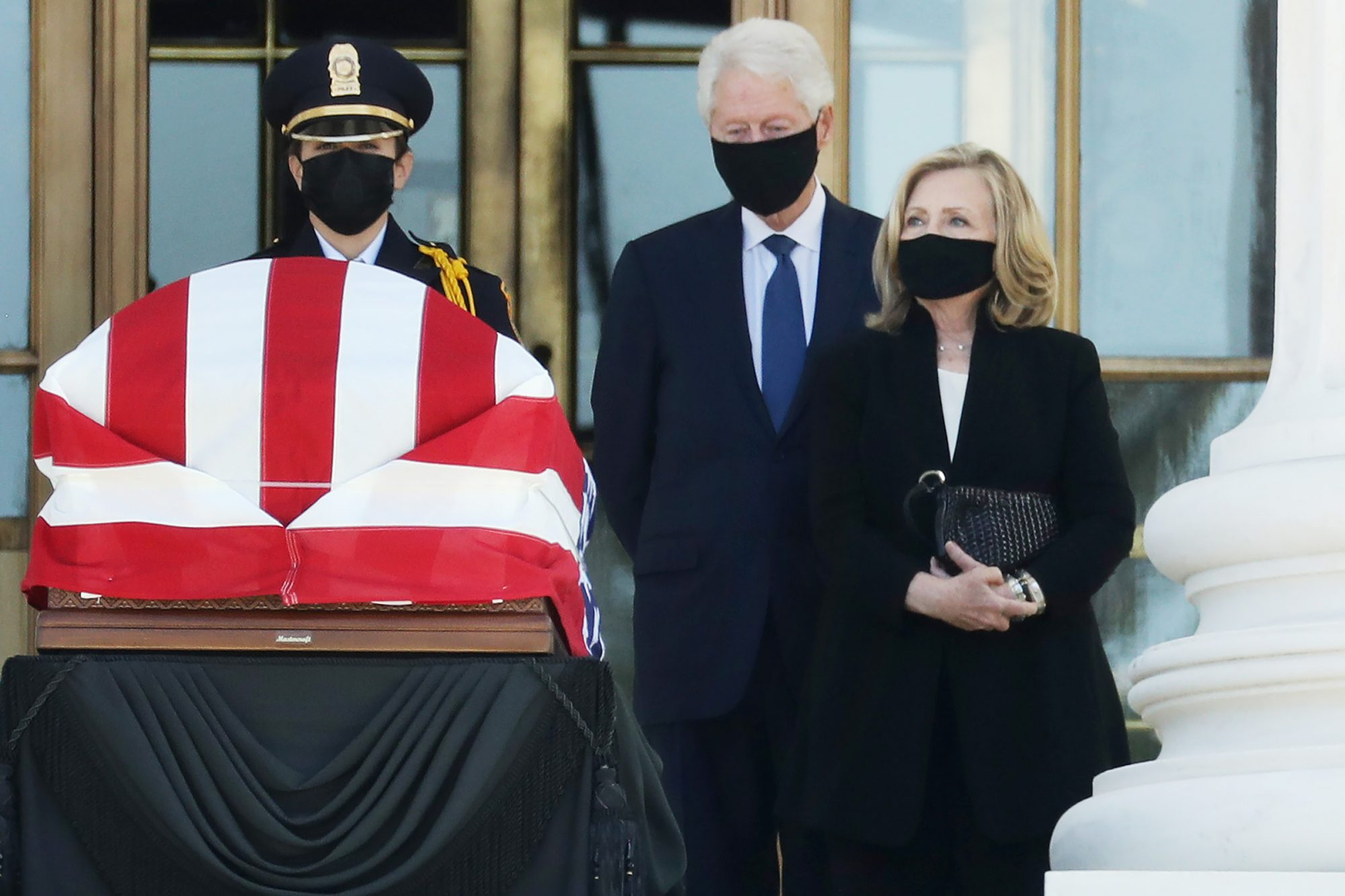 Former President Bill Clinton and former Secretary of State Hillary Clinton pay respects as Justice Ruth Bader Ginsburg