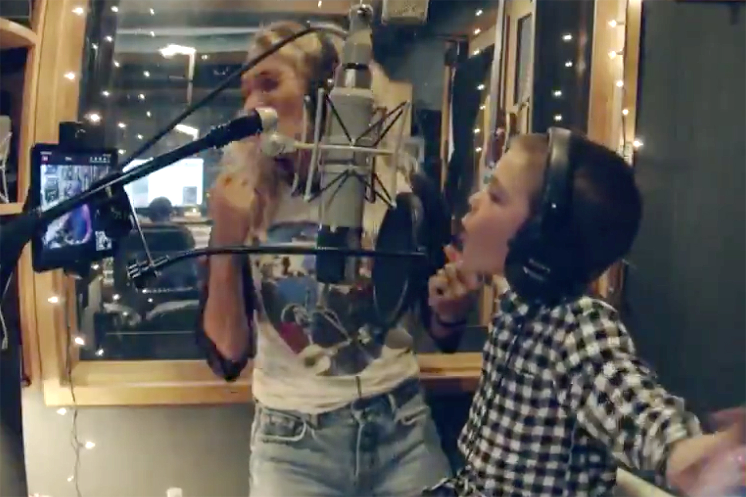 Carrie Underwood and her son in the studio