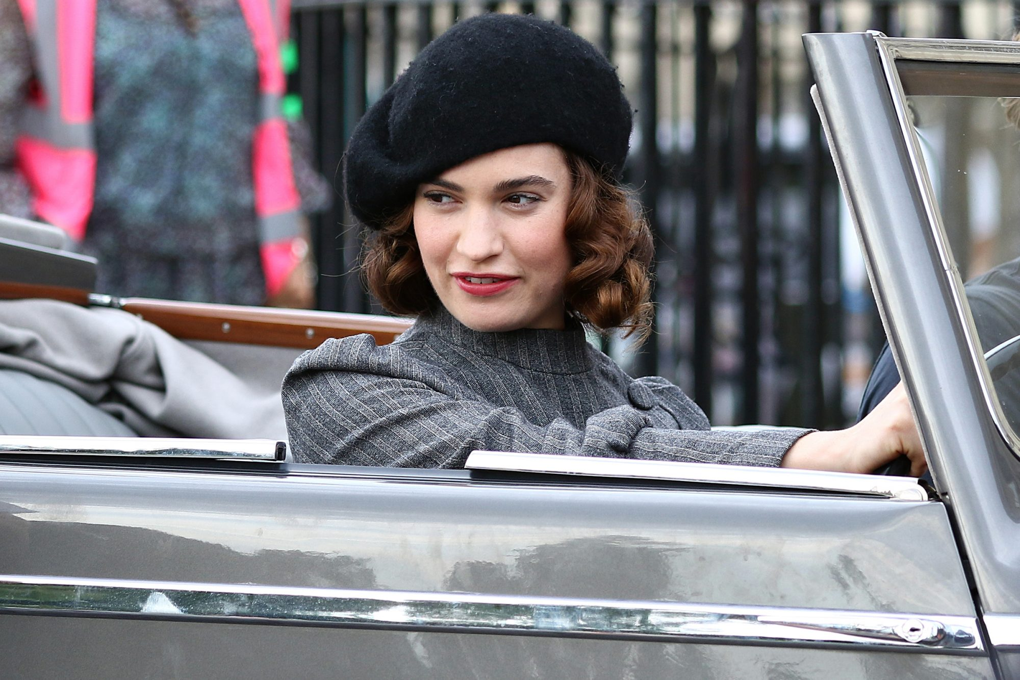 Lily James Driving A Vintage Convertible Jaguar While Filming For New BBC Romantic Comedy Drama The Pursuit Of Love In Bath