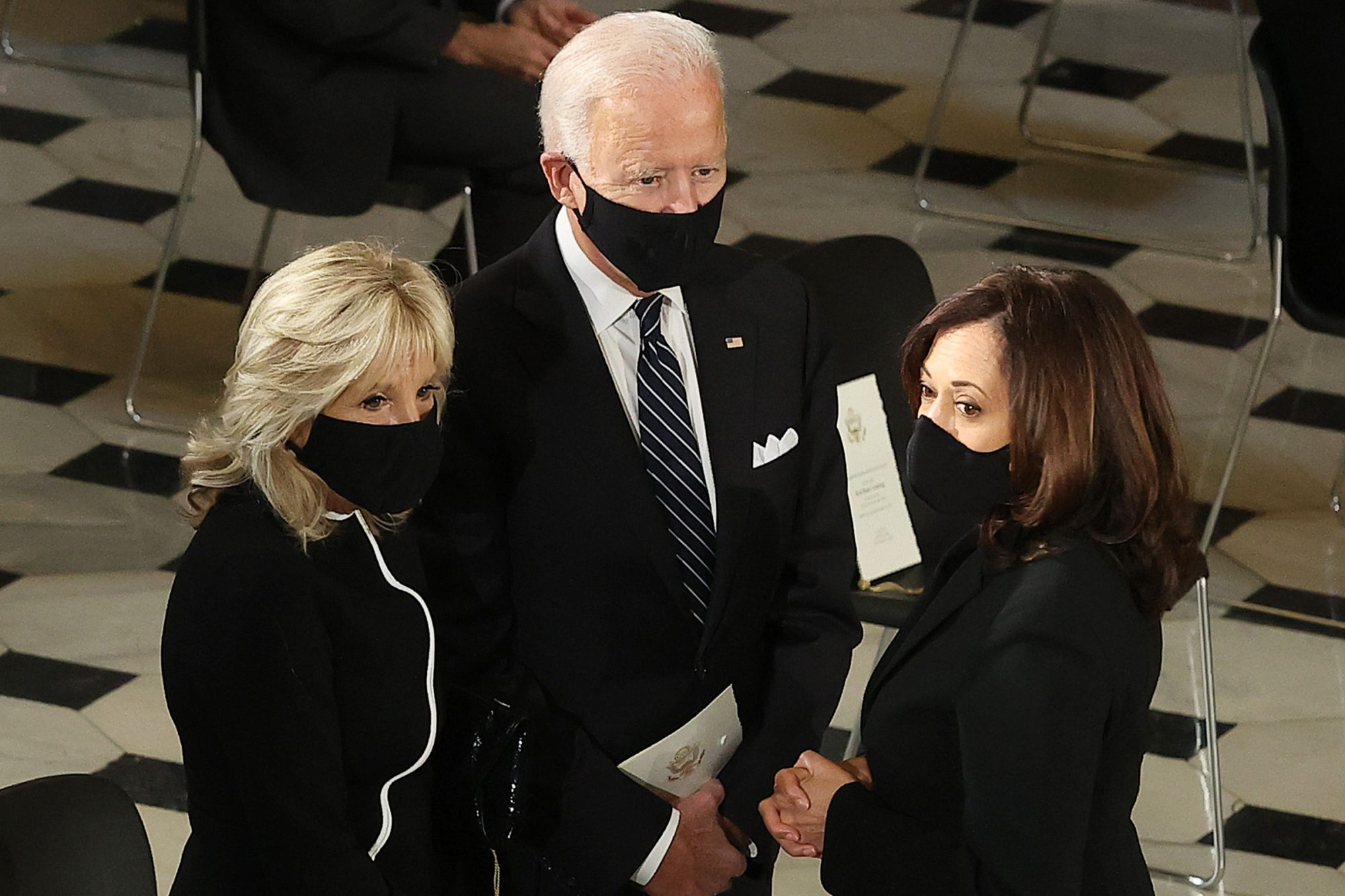 Democratic Presidential Candidate Joe Biden stands with Democratic Vice Presidential candidate Sen. Kamala Harris (D-CA) and his wife Dr. Jill Biden (L) during a ceremony where U.S. Supreme Court Associate Justice Ruth Bader Ginsburg's flag-draped casket will lie in state at the U.S. Capitol