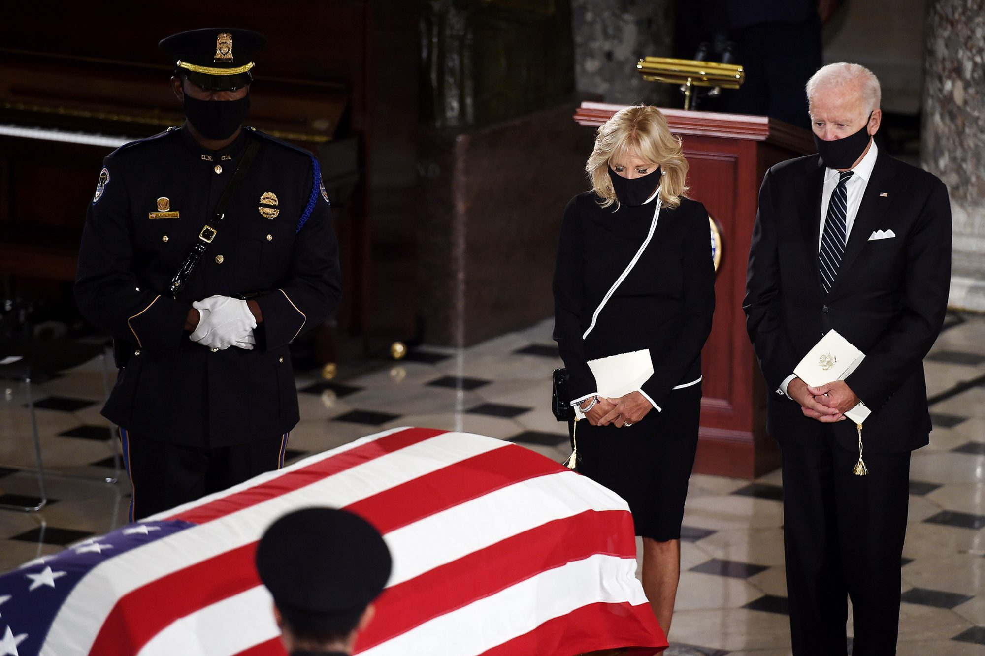 Democratic Presidential nominee Joe Biden and his wife Dr. Jill Biden pay their respects in front of the American flag draped casket of U.S. Supreme Court Associate Justice Ruth Bader Ginsburg as she lies in state at the U.S. Capitol on September 25, 2020 in Washington, DC