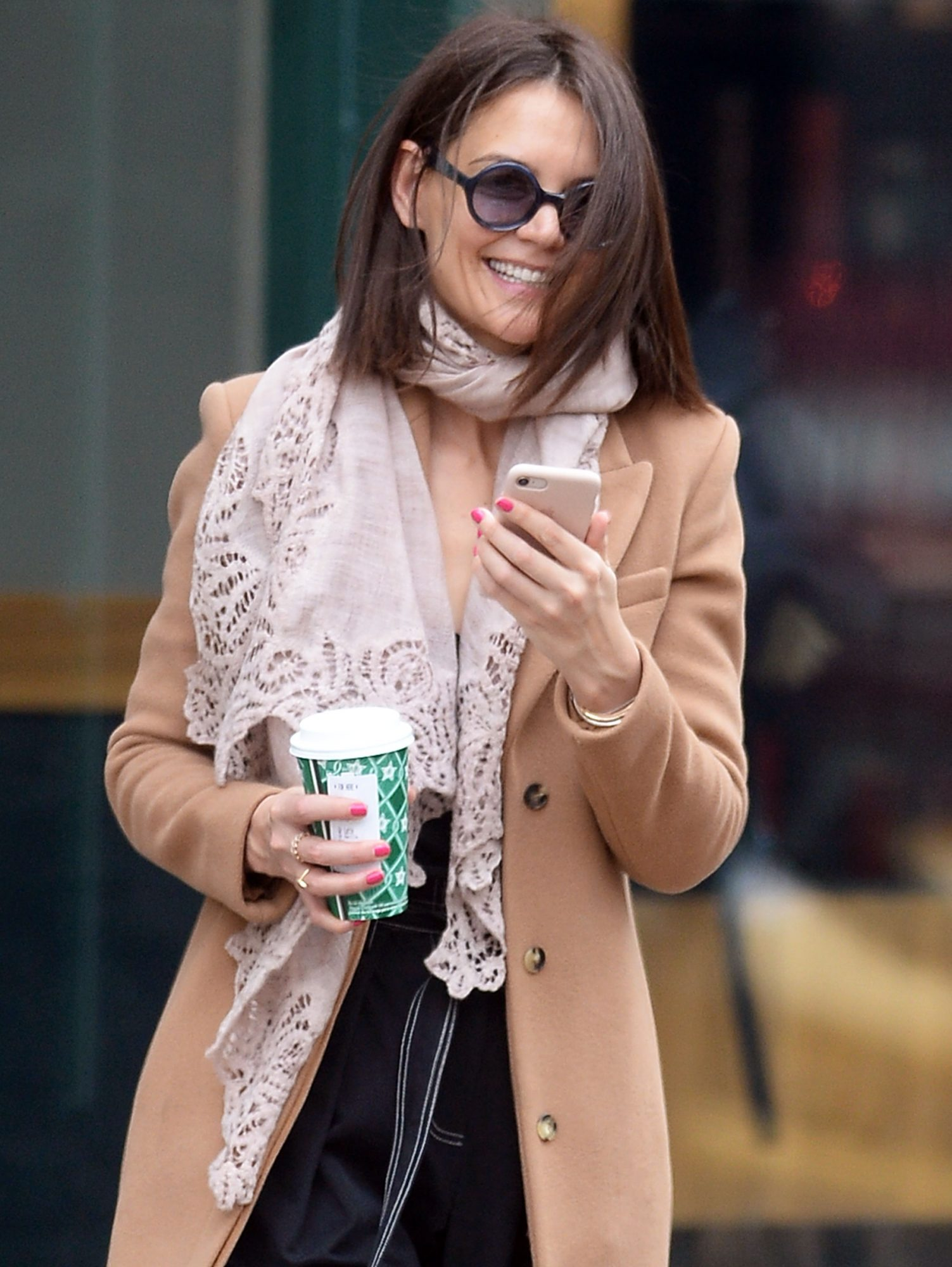 Katie Holmes Is All Smiles Reading A Text On Her Cellphone While Getting Her Morning Coffee In New York City After Celebrating Christmas