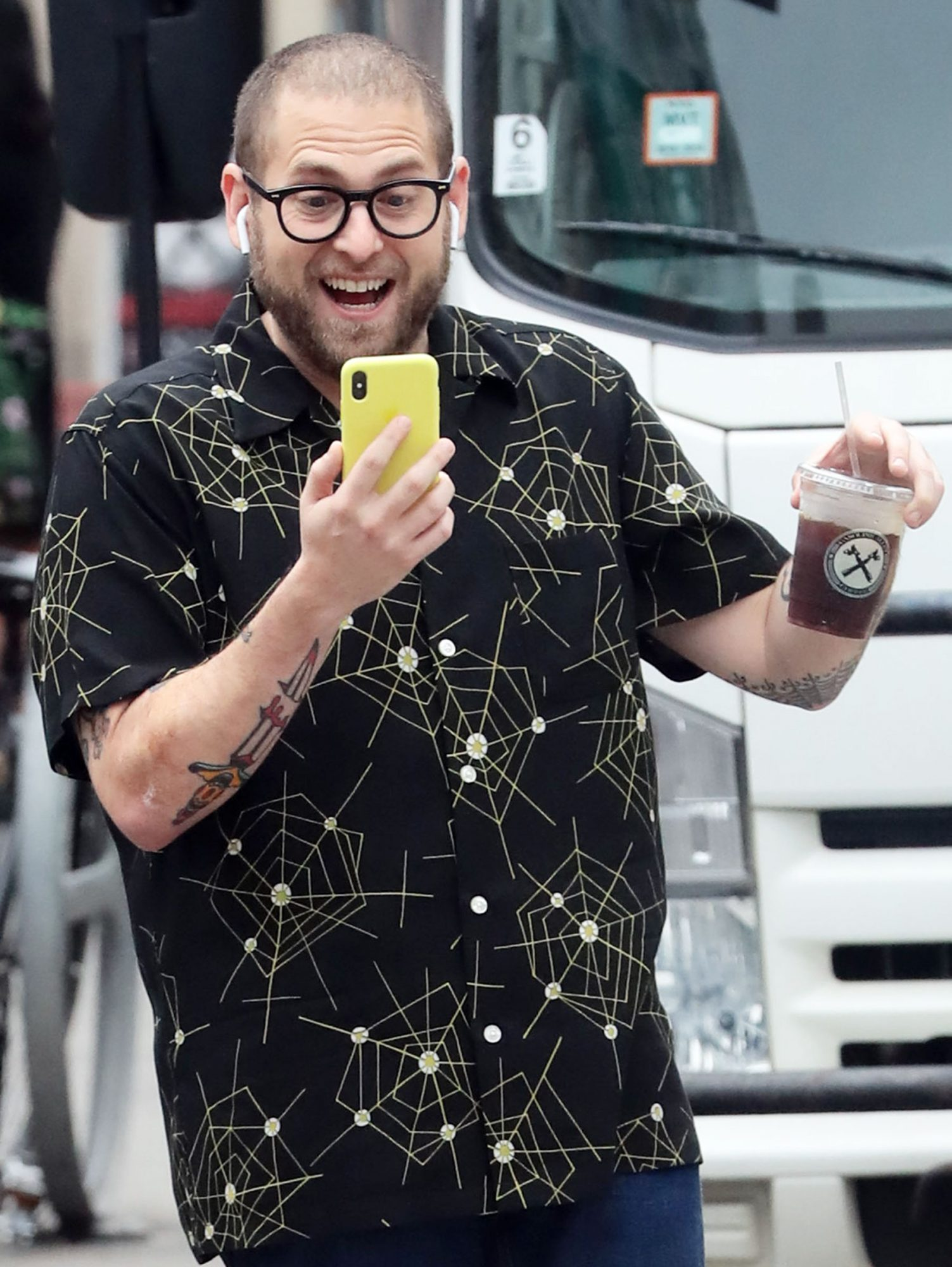 Jonah Hill carrying an ice coffee