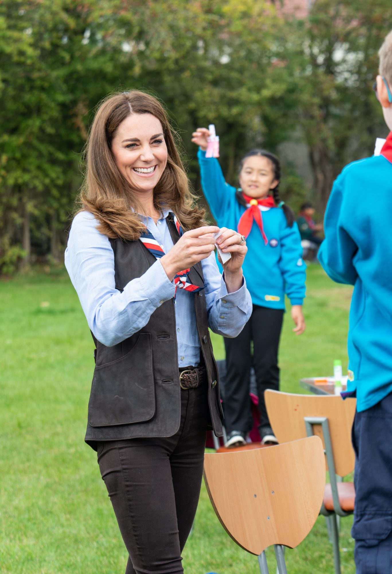 Britain's Catherine, Duchess of Cambridge talks with members of the Beavers as she visits a Scout Group in Northolt