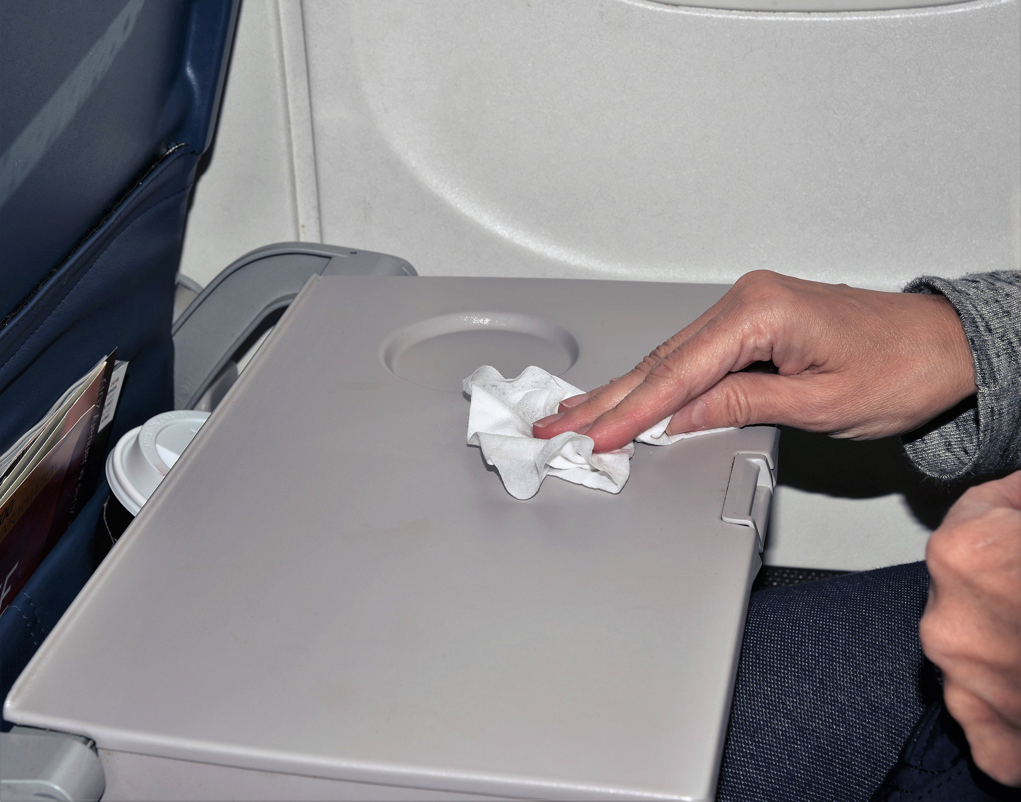 cleaning airplane tray