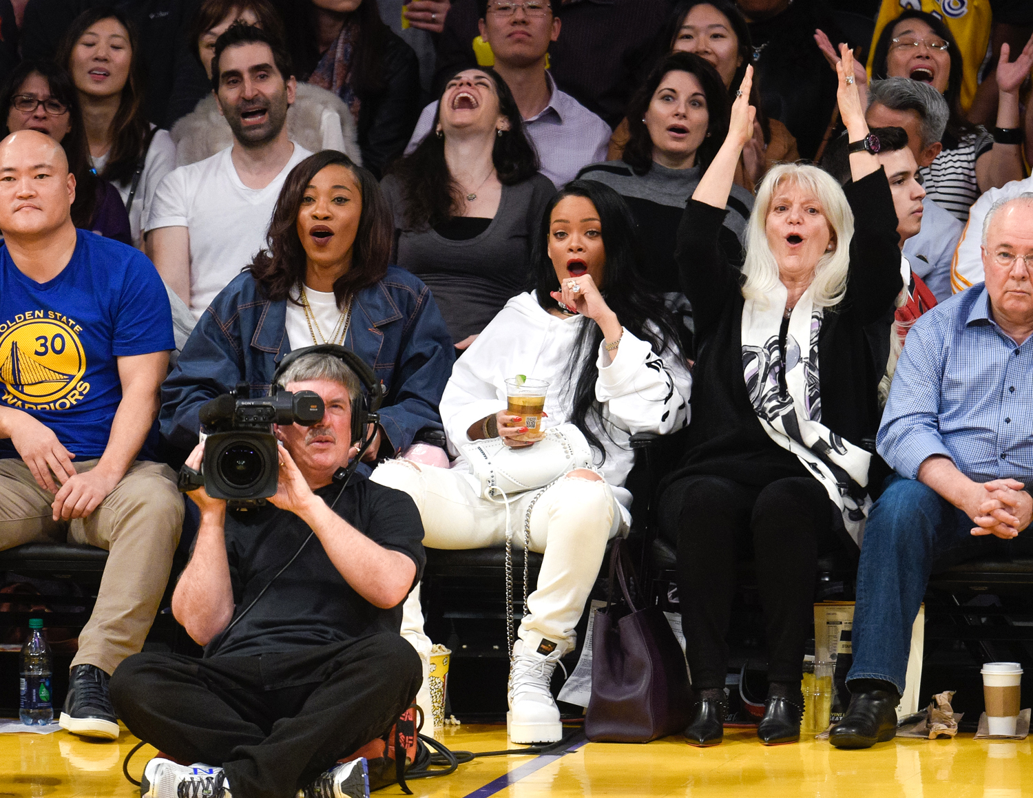 Rihanna attends a basketball game between the Golden State Warriors and the Los Angeles Lakers