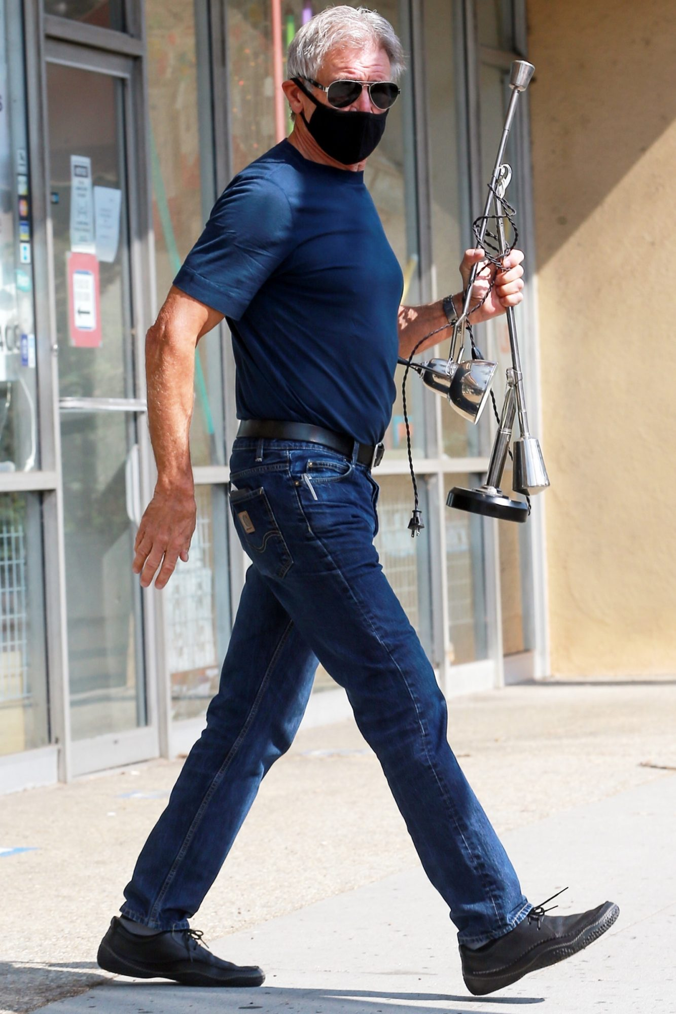 Harrison Ford takes his lamp to fix at Light Bulbs unlimited store
