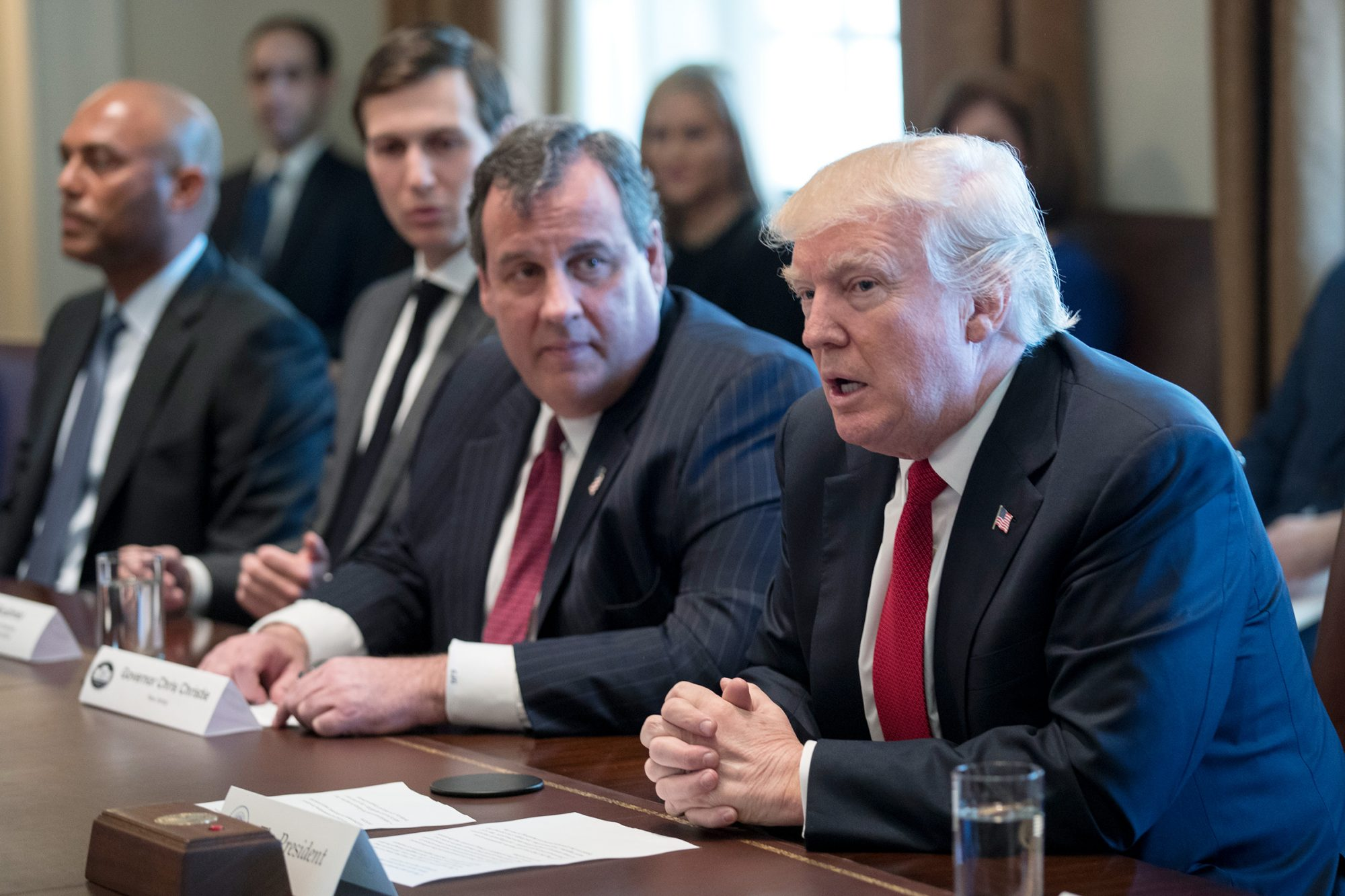 U.S. President Donald Trump (L) and New Jersey Gov. Chris Christie attend a panel discussion on an opioid and drug abuse in the Roosevelt Room of the White House March 29, 2017 in Washington
