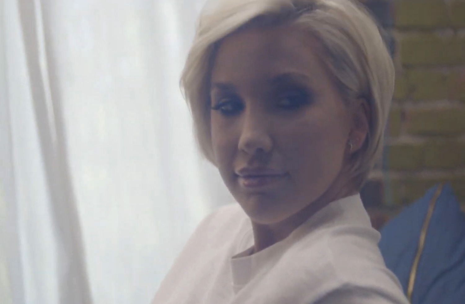 Savannah Chrisley appearing in the music video Levi Denim