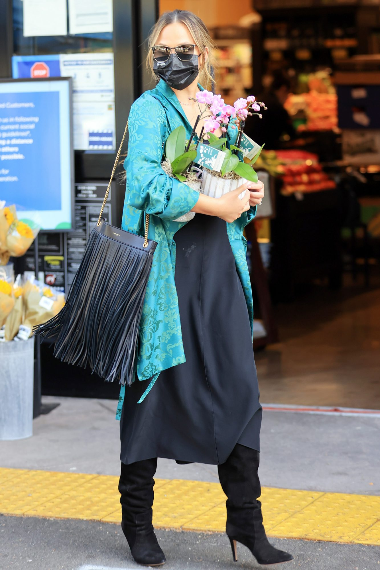 Chrissy Teigen buys flowers during shopping trip with her mom Vilailuck Teigen