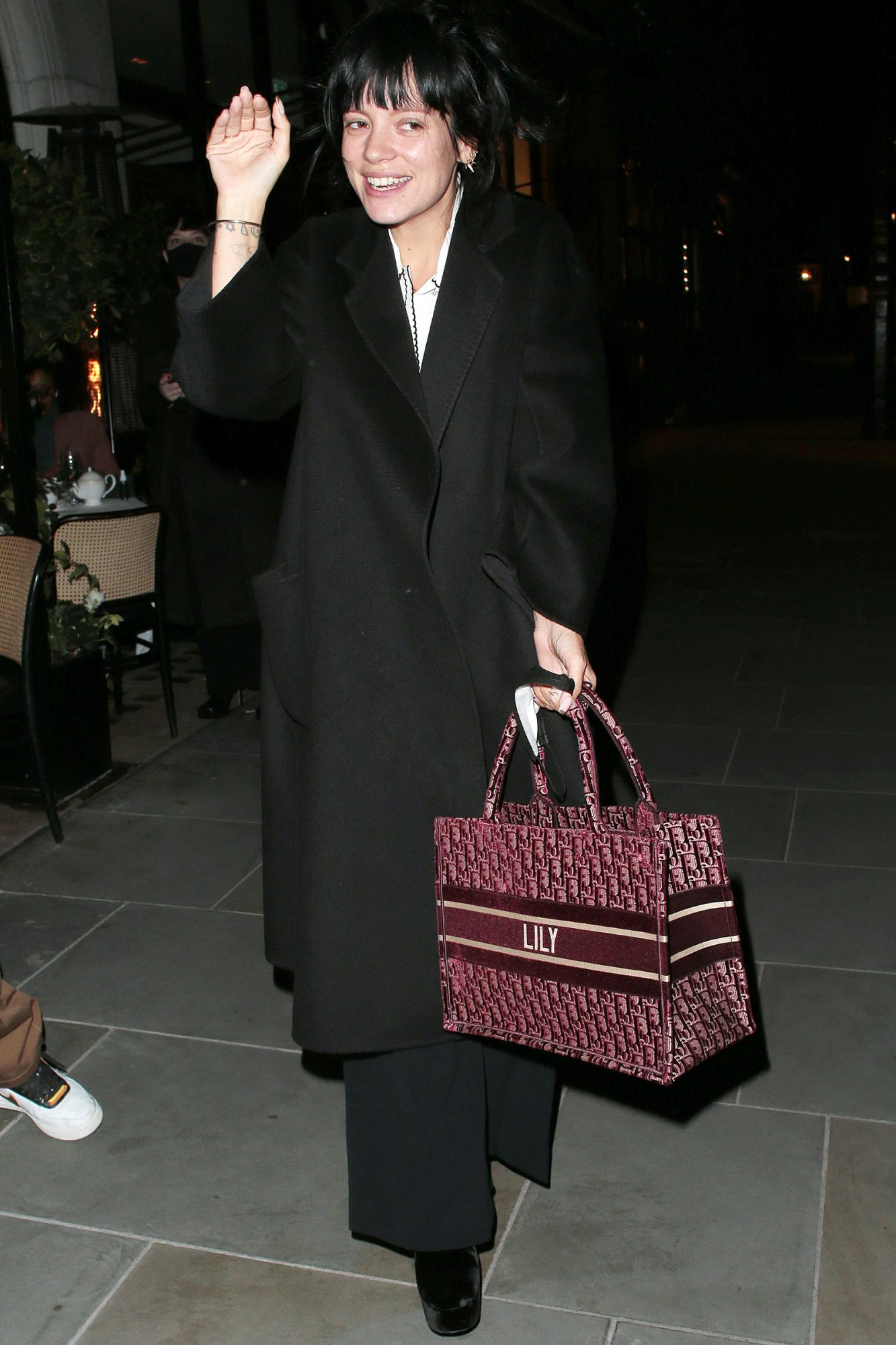 Lilly Allen seen on a night out with a friend leaving Scott's restaurant wearing a Christian Dior bag with her name embroidered on it on October 19, 2020