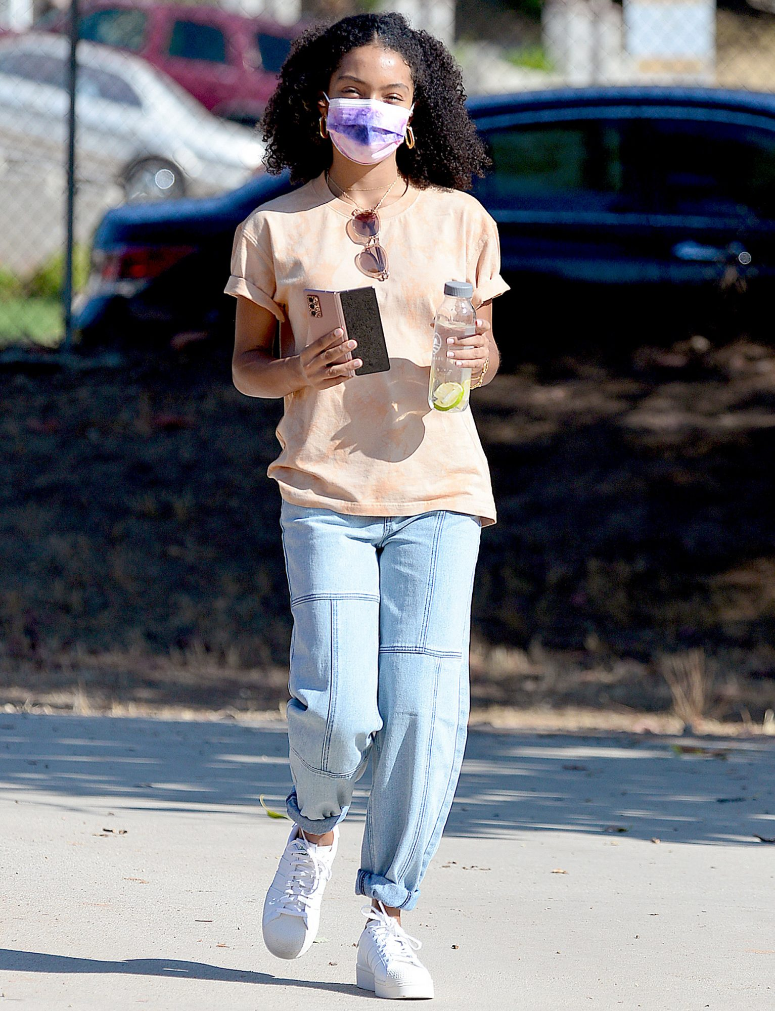Yara Shahidi steps out wearing a PacSun shirt and denim while enjoying a day in the park with her brother