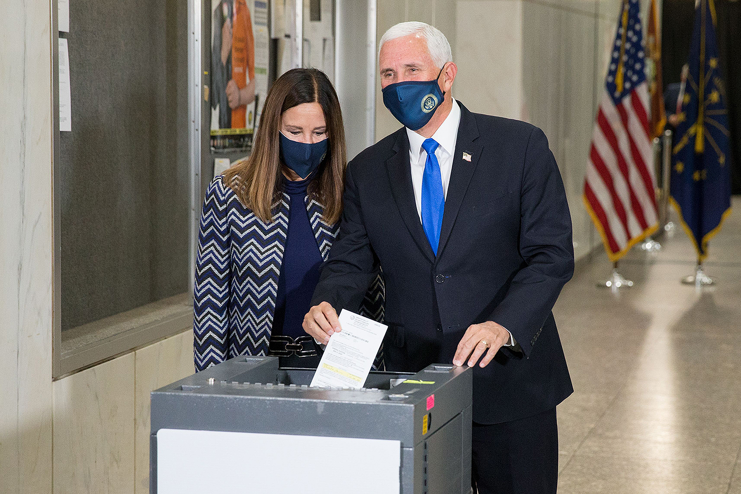 Mike and Karen Pence voting