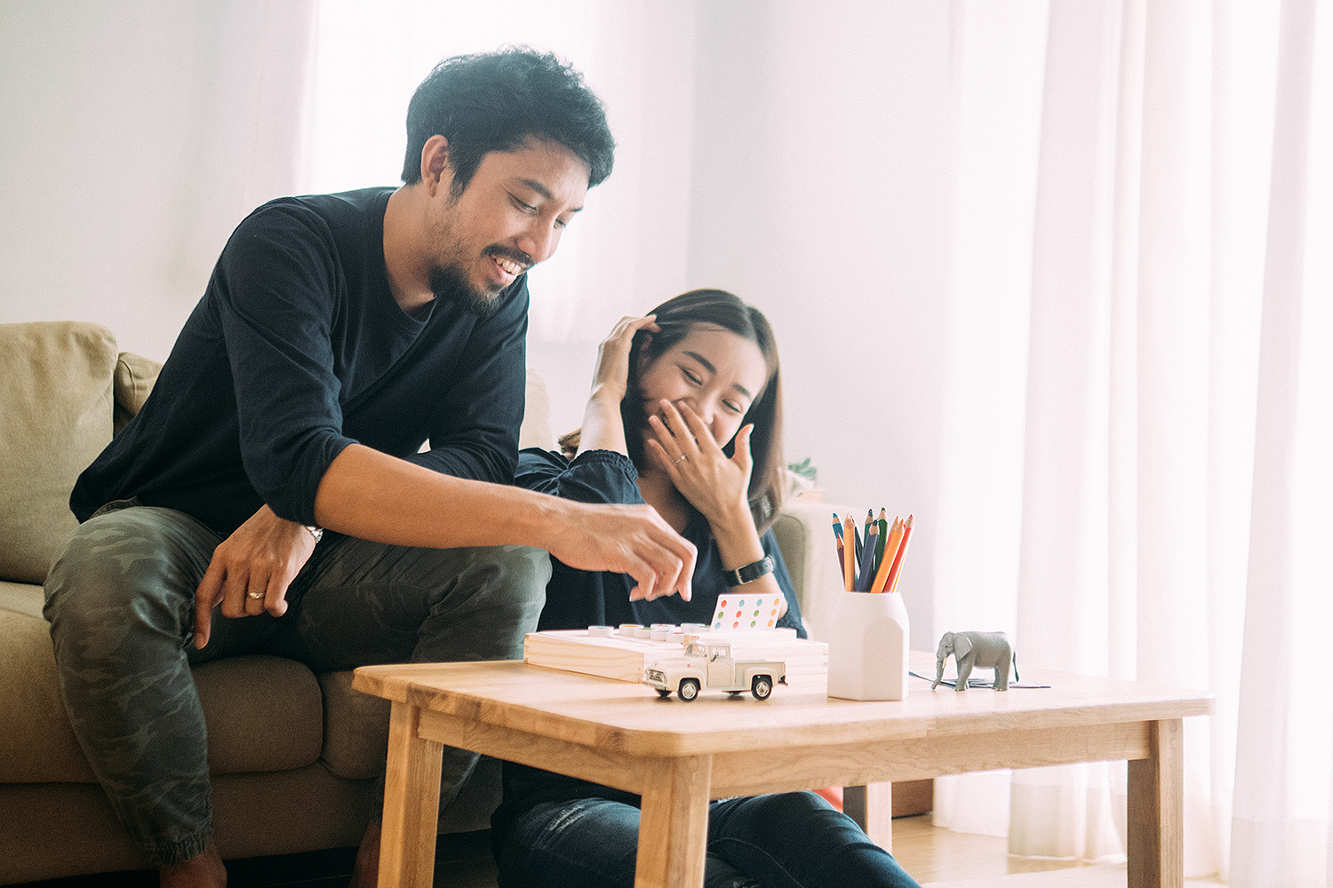 couple playing board game